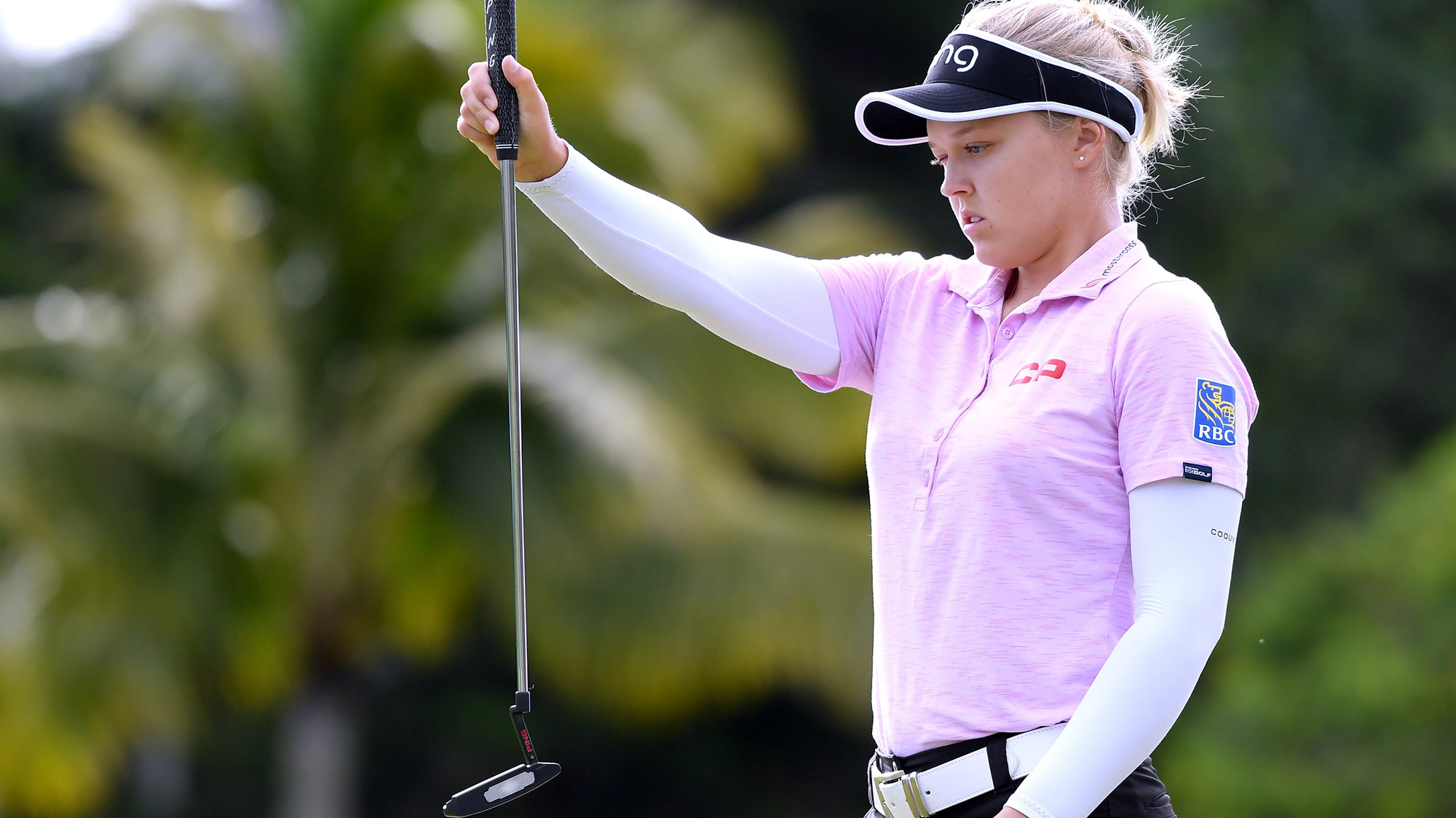 Brooke Henderson Lines Up a Putt in Hawaii