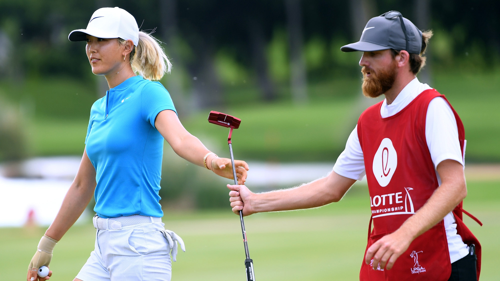 Michelle Wie Hands Her Putter Back at LOTTE