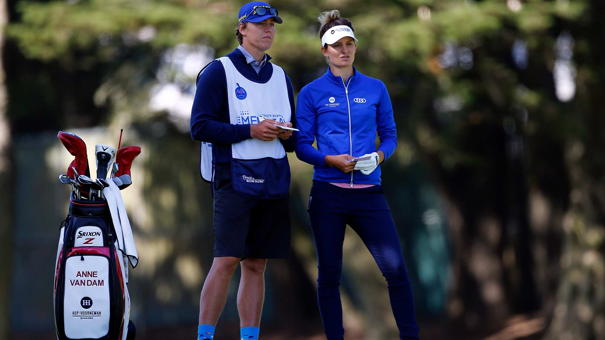 Anne van Dam of the Netherlands talks to her caddie on the 18th hole during the first round of the LPGA Mediheal Championship
