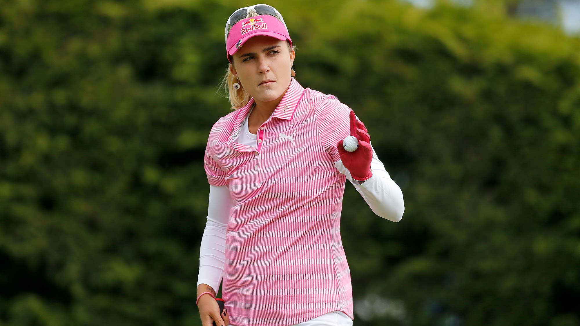 Lexi Thompson waves after making a putt on the 18th hole during the third round of the LPGA Mediheal Championship