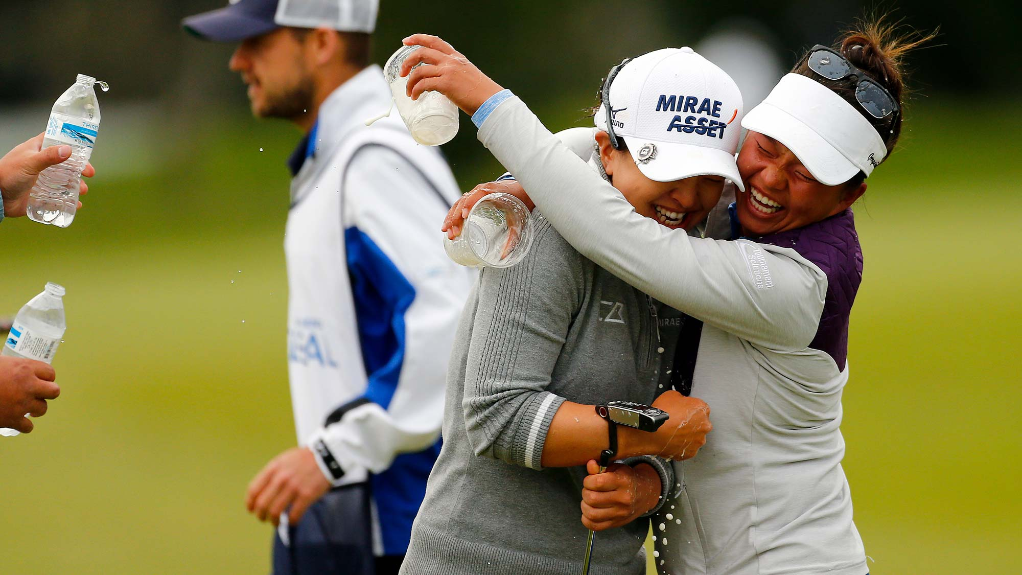 Sei Young Kim of South Korea is hugged by Meghan Kang after making a birdie putt in a sudden death playoff to win during the final round of the LPGA Mediheal Championship