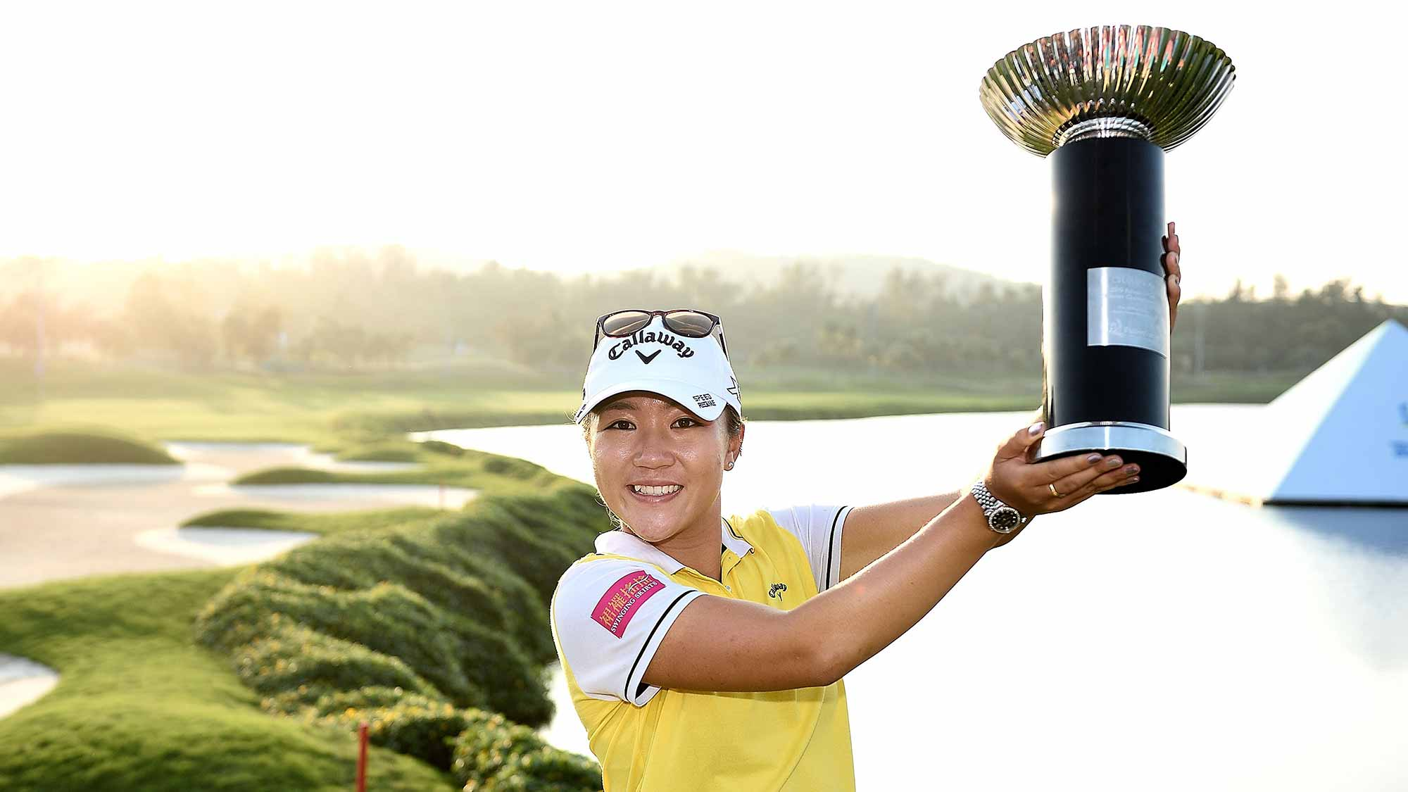 Lydia Ko poses with the trophy on the 18th green after winning 2015 Fubon LPGA Taiwan Championship on October 25, 2015 in Miramar Resort & Country Club