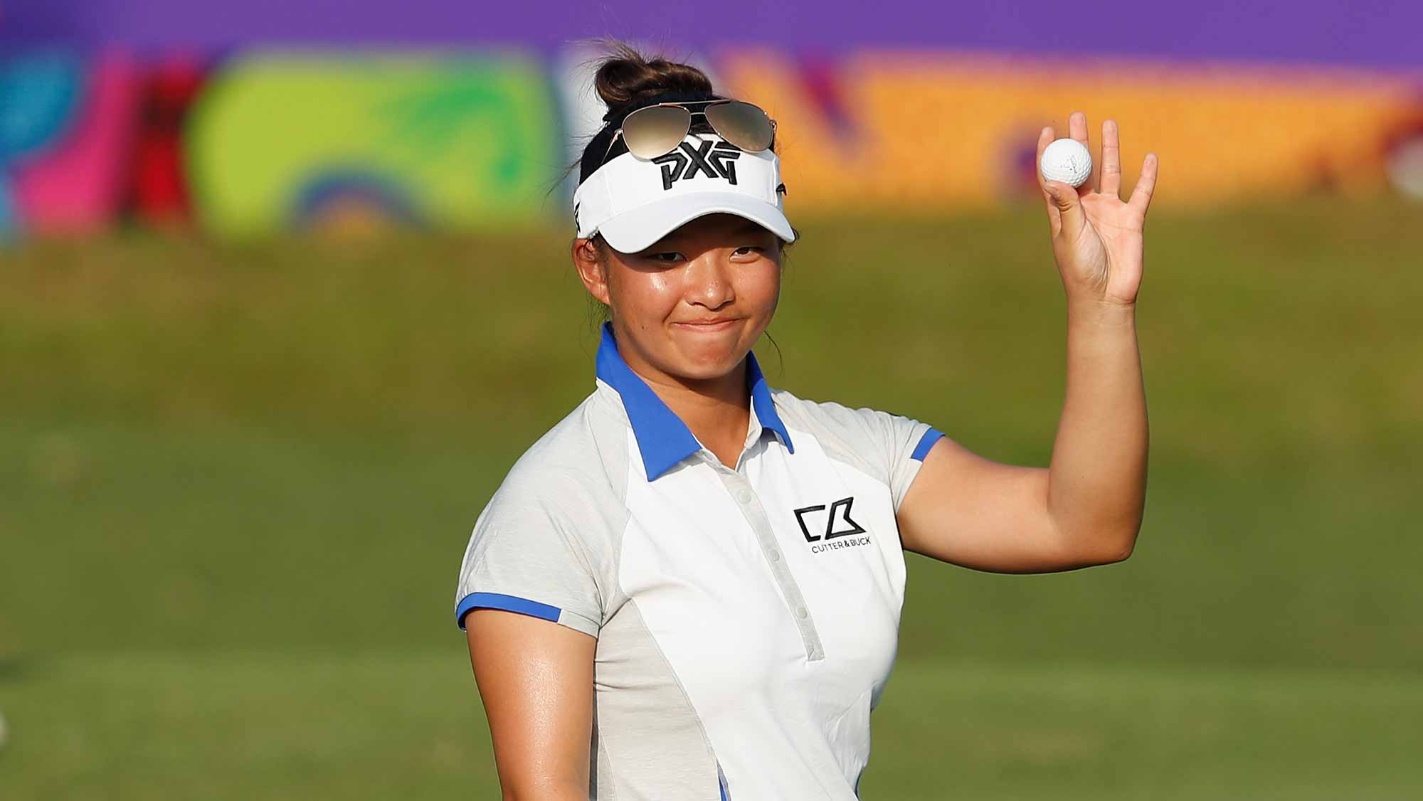 Megan Khang of United States acknowledges to the spectators at the eighteen hole during the second round of the Swinging Skirts LPGA Taiwan Championship at Ta Shee Golf & Country Club on October 26, 2018 in Taoyuan, Chinese Taipei