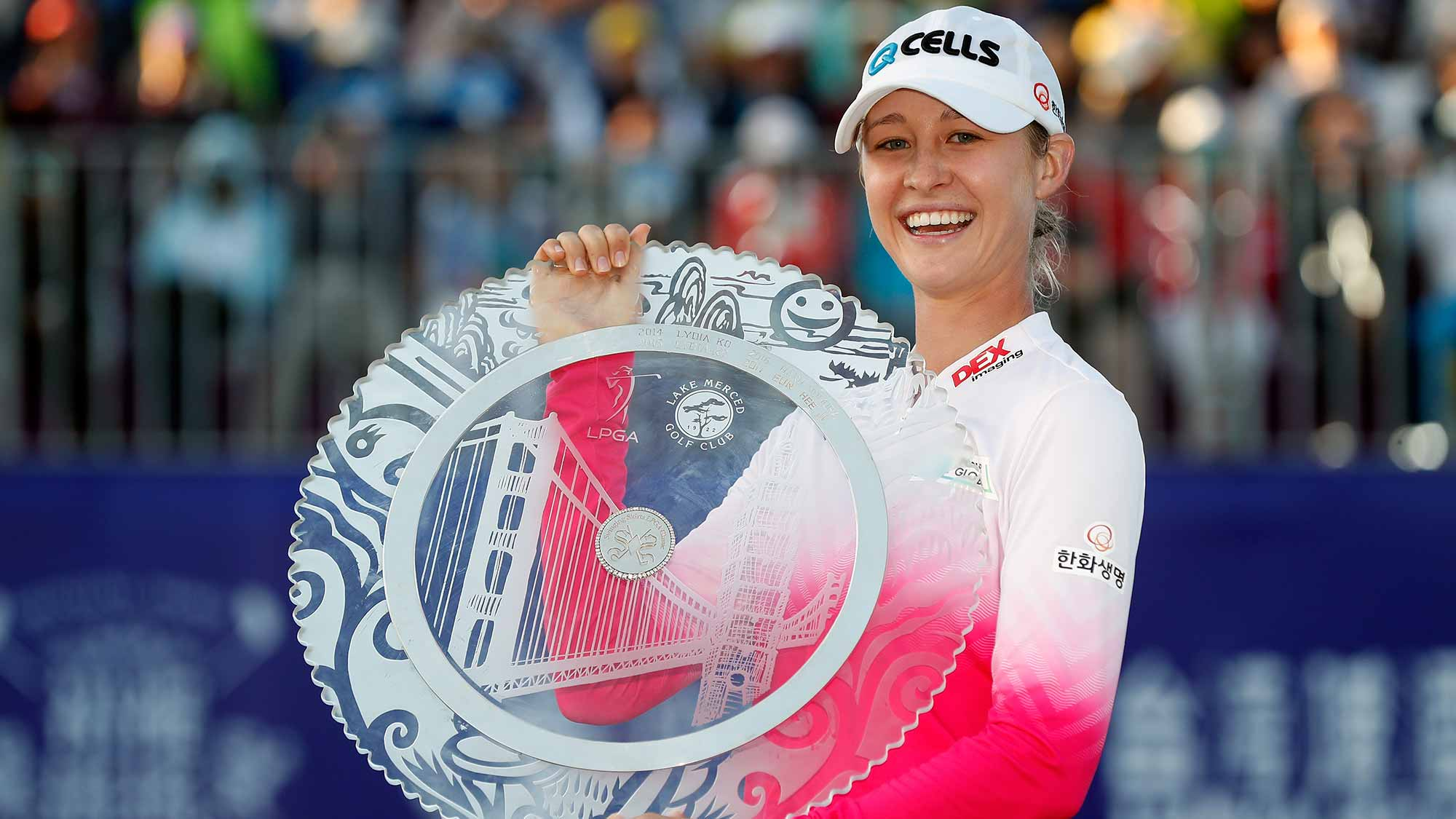 Nelly Korda poses with her trophy on the 18th green after winning the Swinging Skirts LPGA Taiwan Championship at Ta Shee Golf & Country Club on October 28, 2018 in Taoyuan, Chinese Taipei