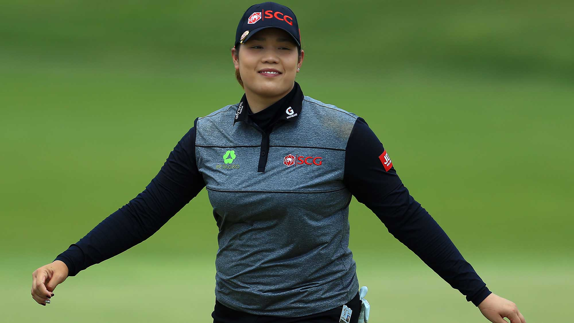 Ariya Jutanugarn of Thailand smiles after sinking her putt on the 1st green during the final round of the Manulife LPGA Classic