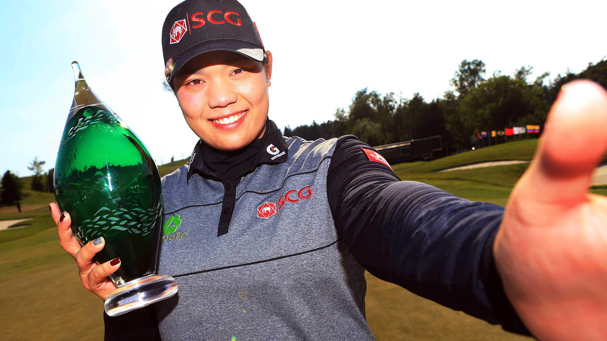 Ariya Jutanugarn of Thailand imitates a 'selfie' after sinking her birdie putt on the 1st playoff hole to win during the final round of the Manulife LPGA Classic