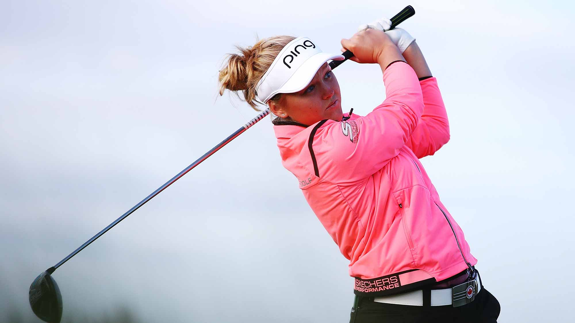 Brooke Henderson of Canada tees off during day one of the McKayson New Zealand Women's Open at Windross Farm