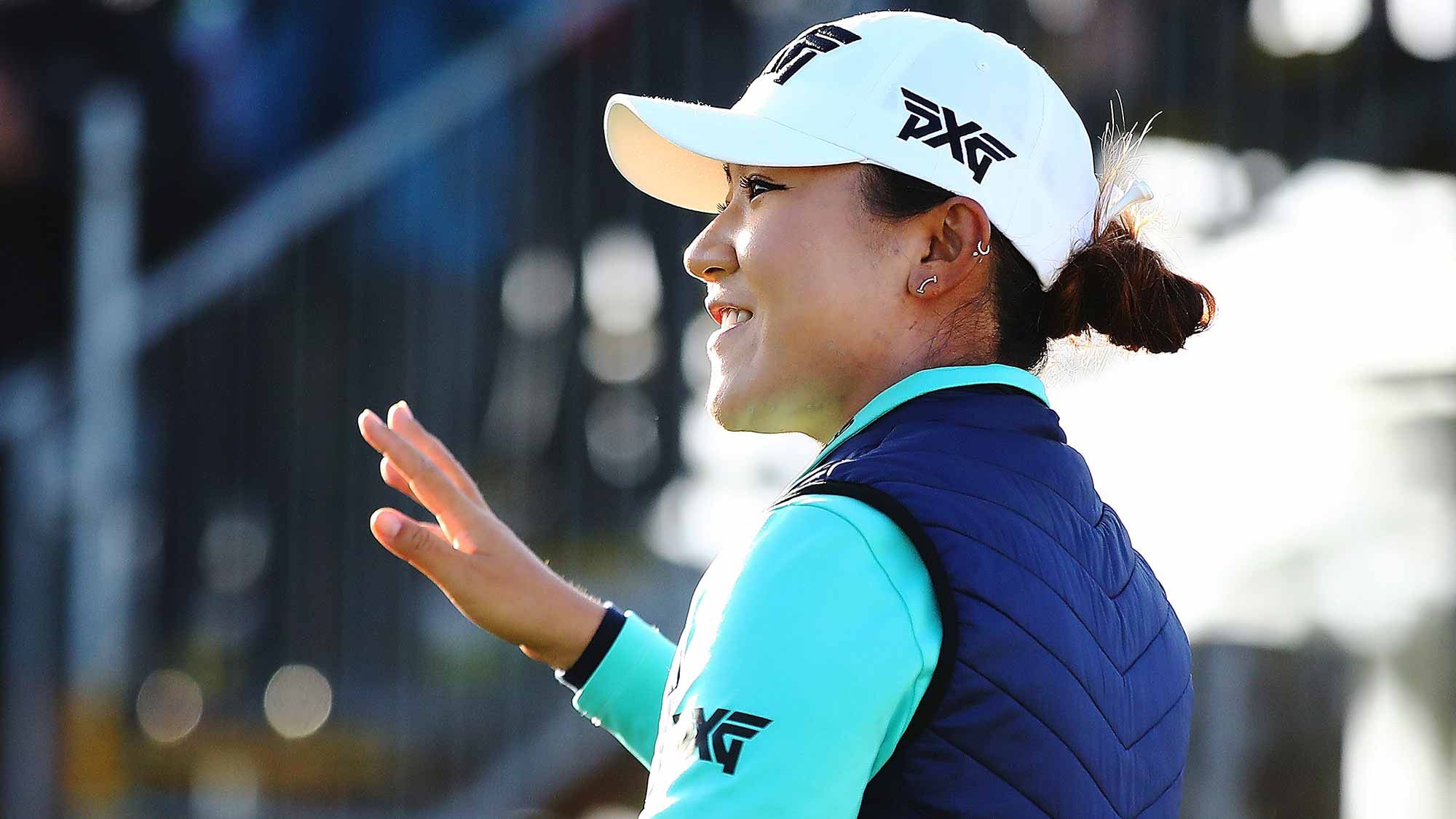 Lydia Ko of New Zealand acknowledges the crowd during day one of the McKayson New Zealand Women's Open at Windross Farm