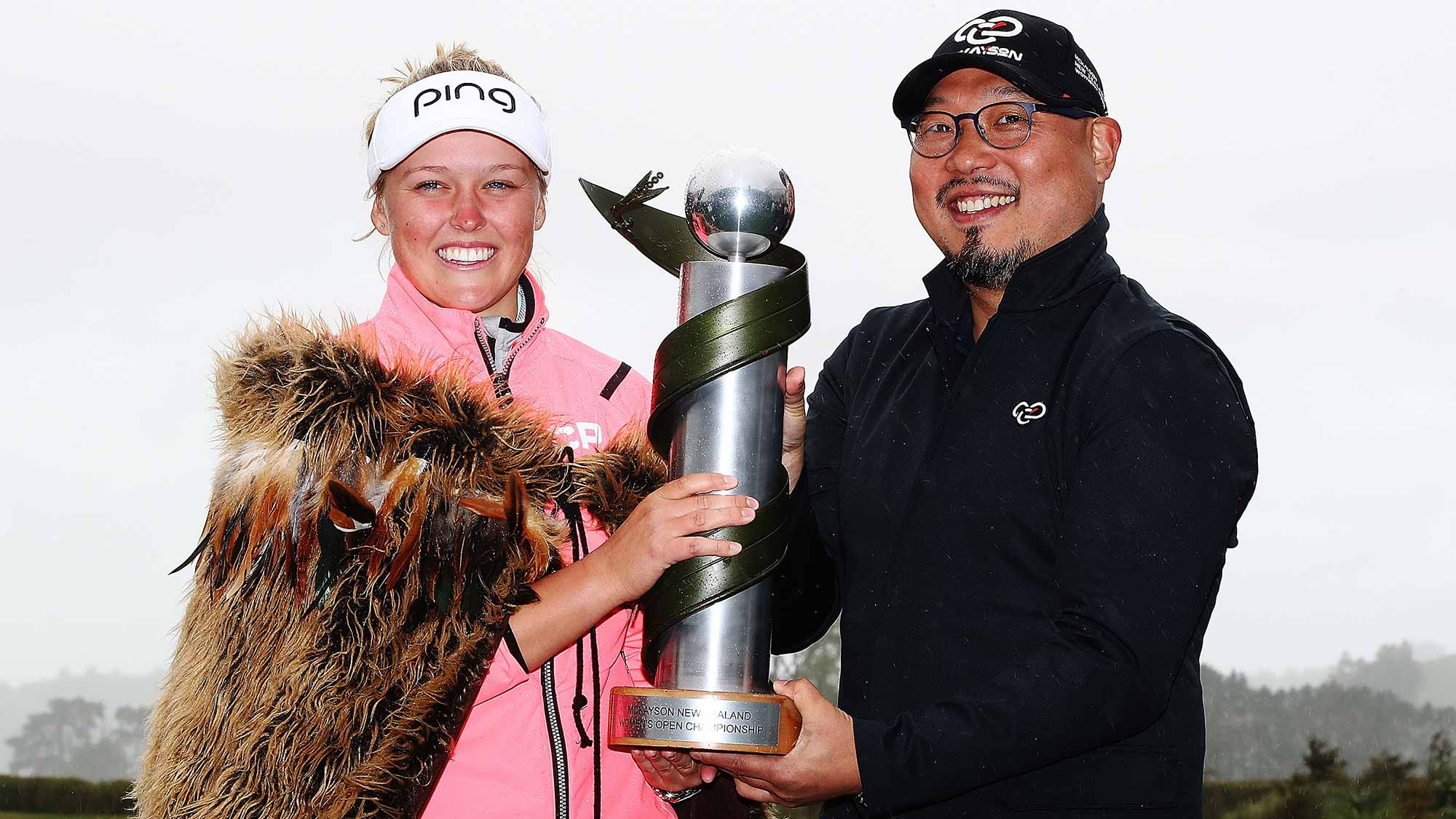 Brooke Henderson of Canada is presented the New Zealand Women's Open trophy by MC Kim during day five of the New Zealand Women's Open at Windross Farm
