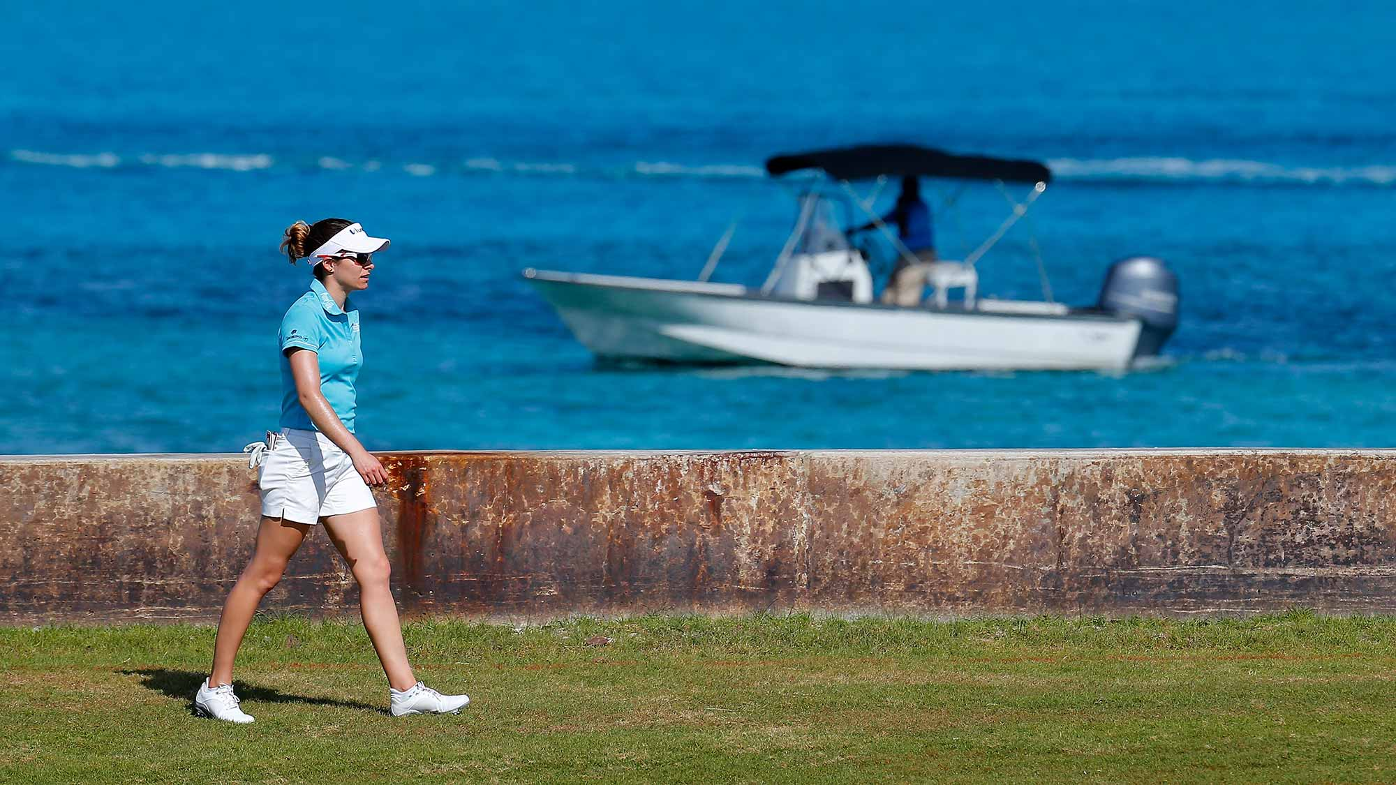 Gaby Lopez of Mexico walks down the eighth hole during the first round of the Pure Silk Bahamas LPGA Classic at the Ocean Club Golf Course