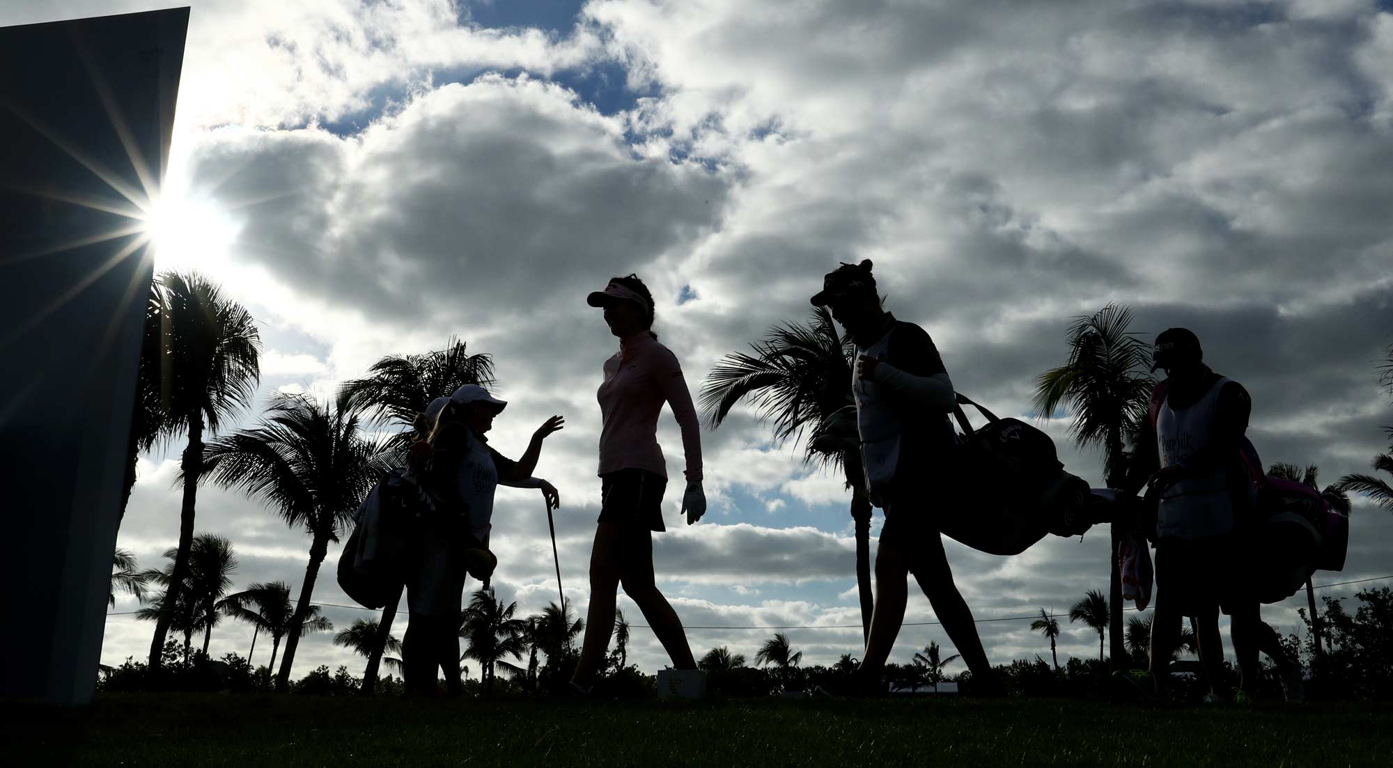 Katie Burnett of the United States, Brittany Lang of the United States and Sandra Gal of Germany prepare to tee off on the fourth hole during round one of the Pure Silk Bahamas LPGA Classic