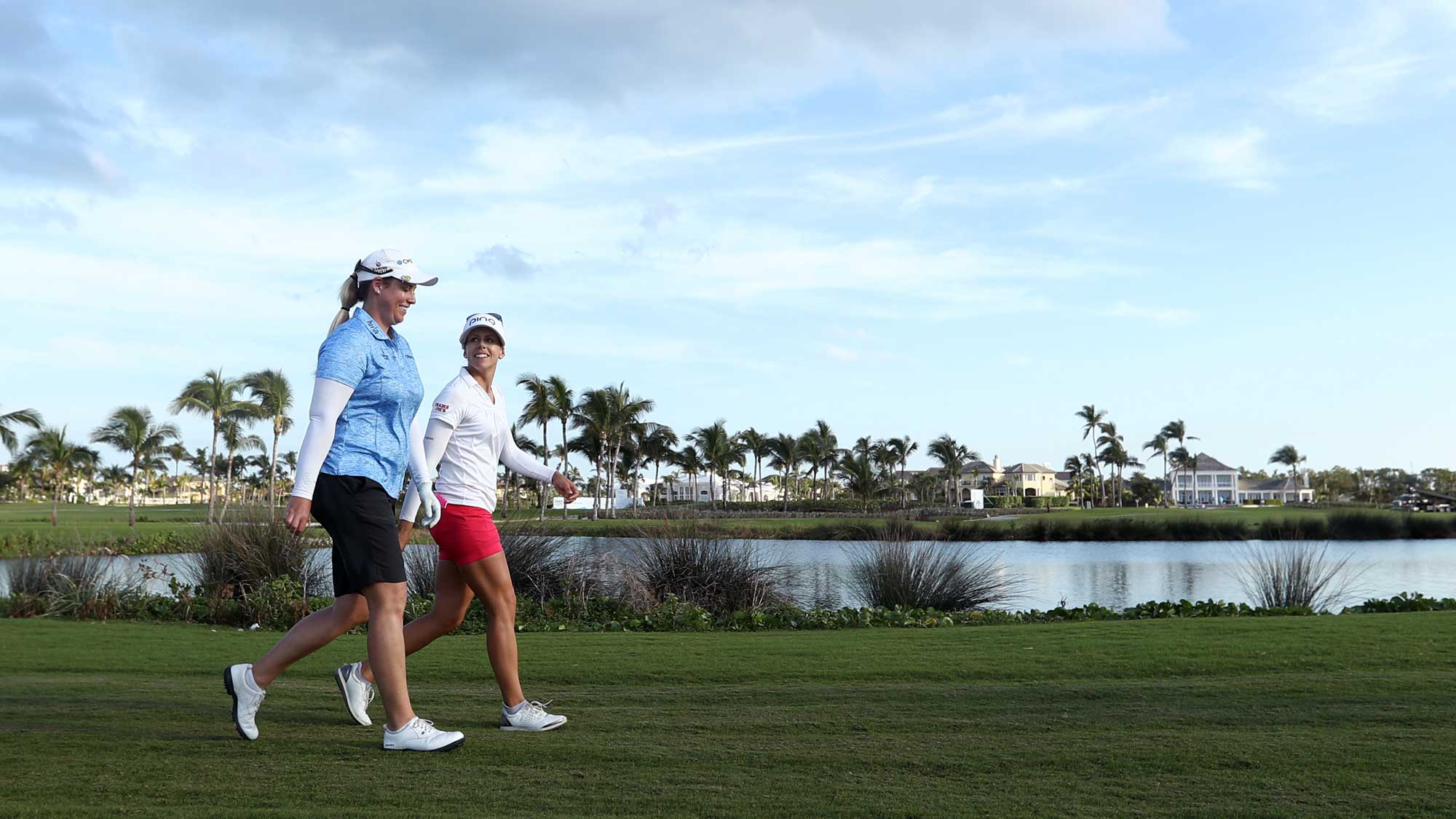 Brittany Lincicome of the United States and Pernilla Lindberg of Sweden walk on nine fairway during round two of the Pure Silk Bahamas LPGA Classic