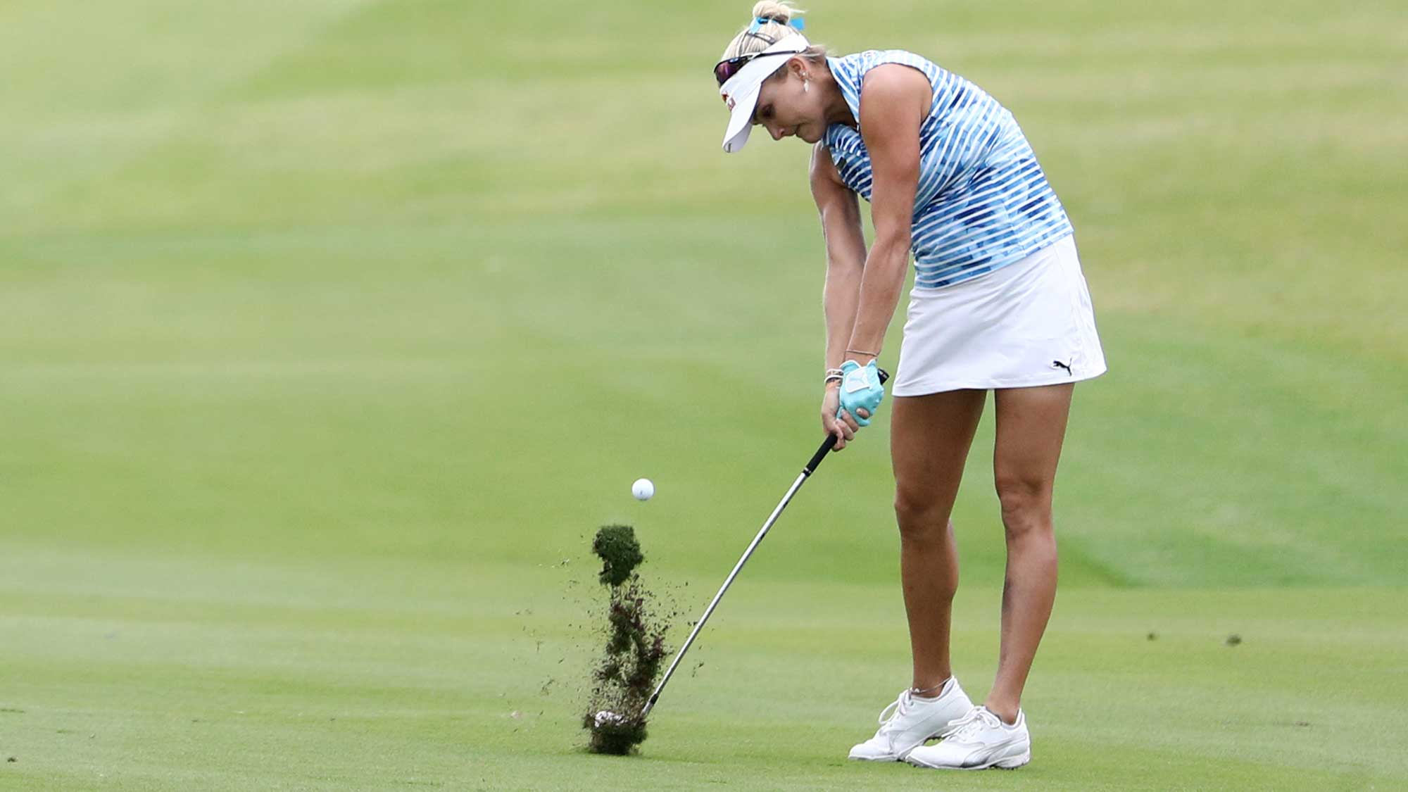 Lexi Thompson of the United States plays her second shot on the eighth hole during the final round of the Pure Silk Bahamas LPGA Classic