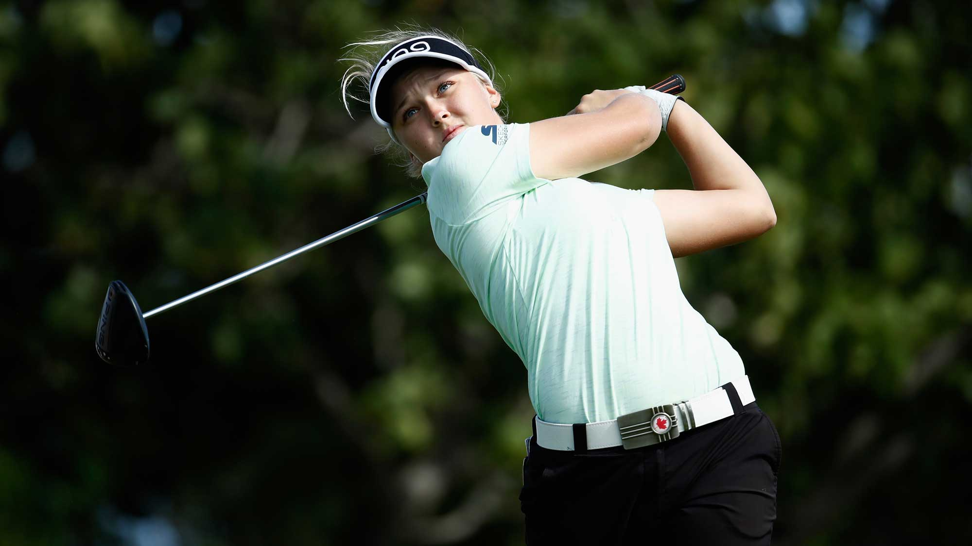 Brooke Henderson of Canada hits her tee shot on the fouth hole during the second round of the Pure Silk Bahamas LPGA Classic