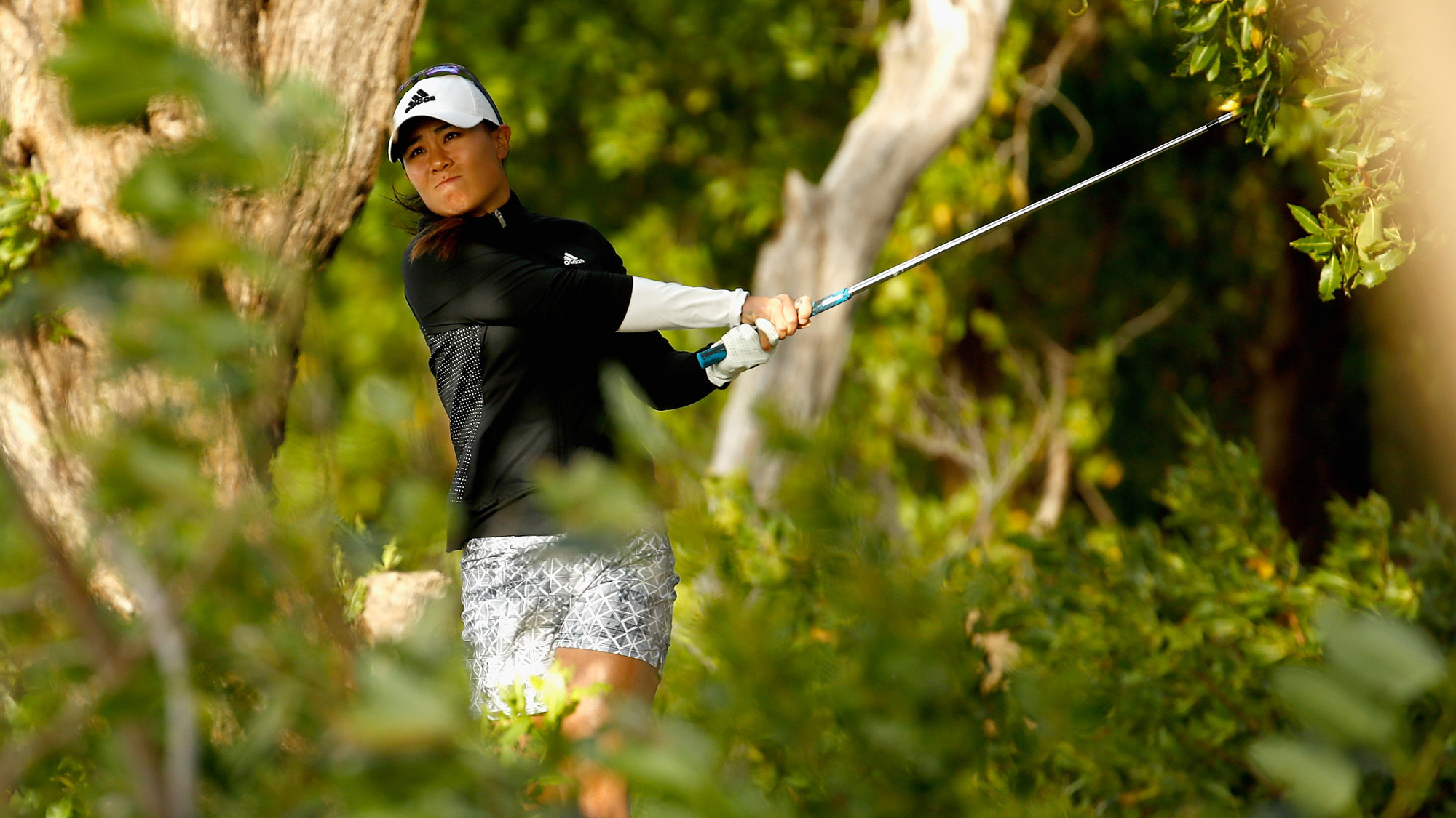 Danielle Kang hits her second shot on the first hole during the second round of the Pure Silk Bahamas LPGA Classic