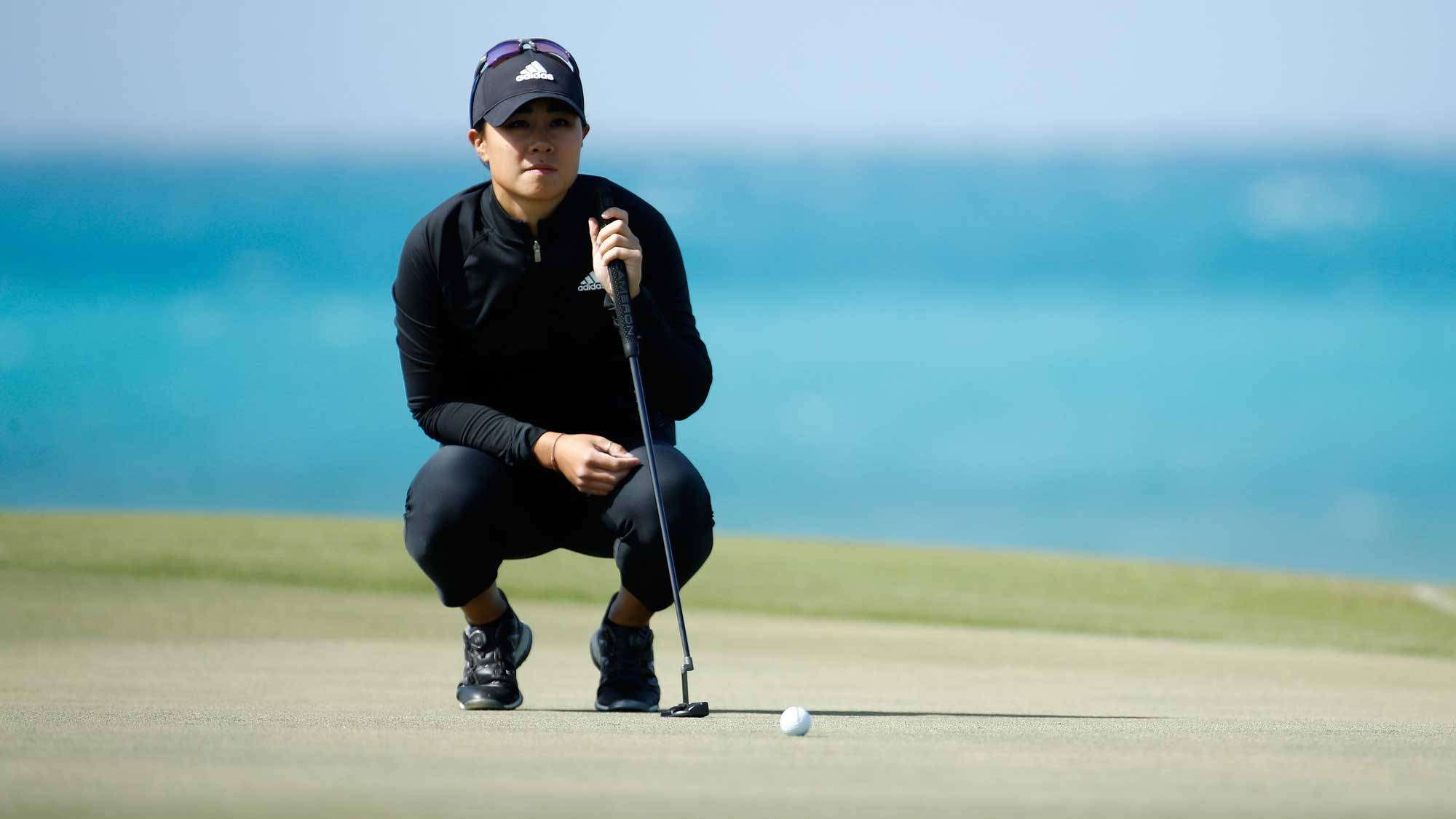 Danielle Kang lines up her putt for birdie on the eighth hole during the second round of the Pure Silk Bahamas LPGA Classic