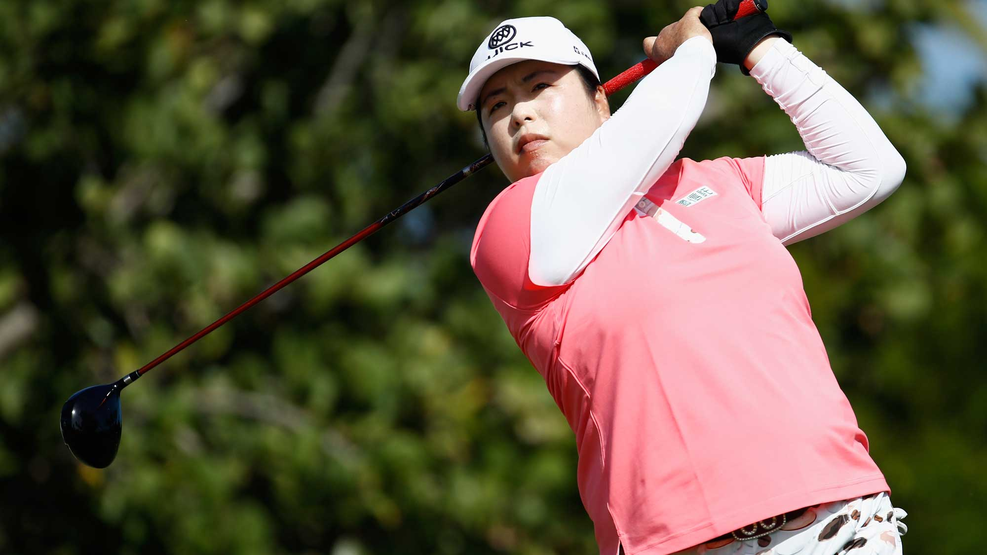 Shanshan Feng of China hits her tee shot on the 4th hole during the final round of the Pure Silk Bahamas LPGA Classic