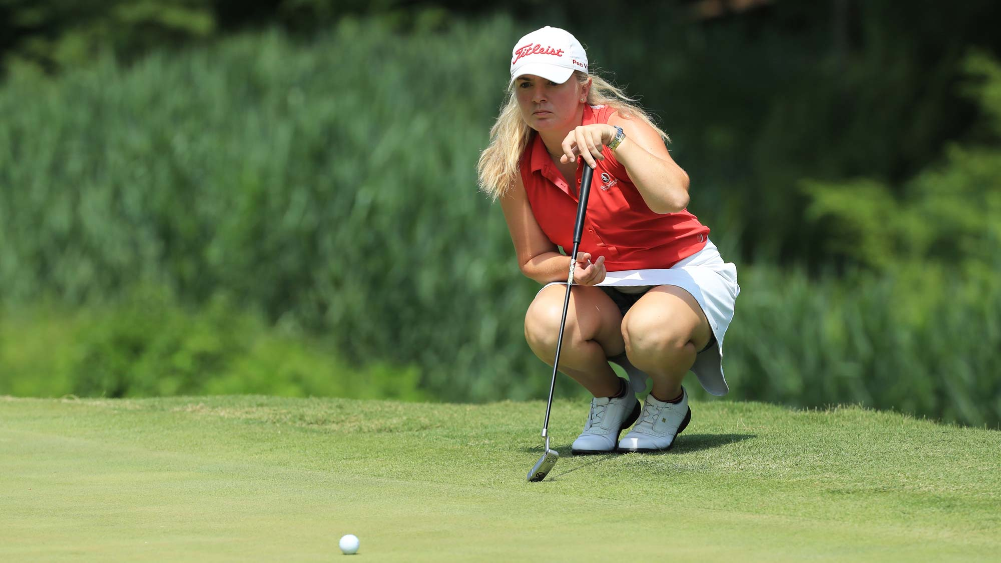 Bronte Law of England lines up her putt on the third hole during the first round of the Pure Silk Championship