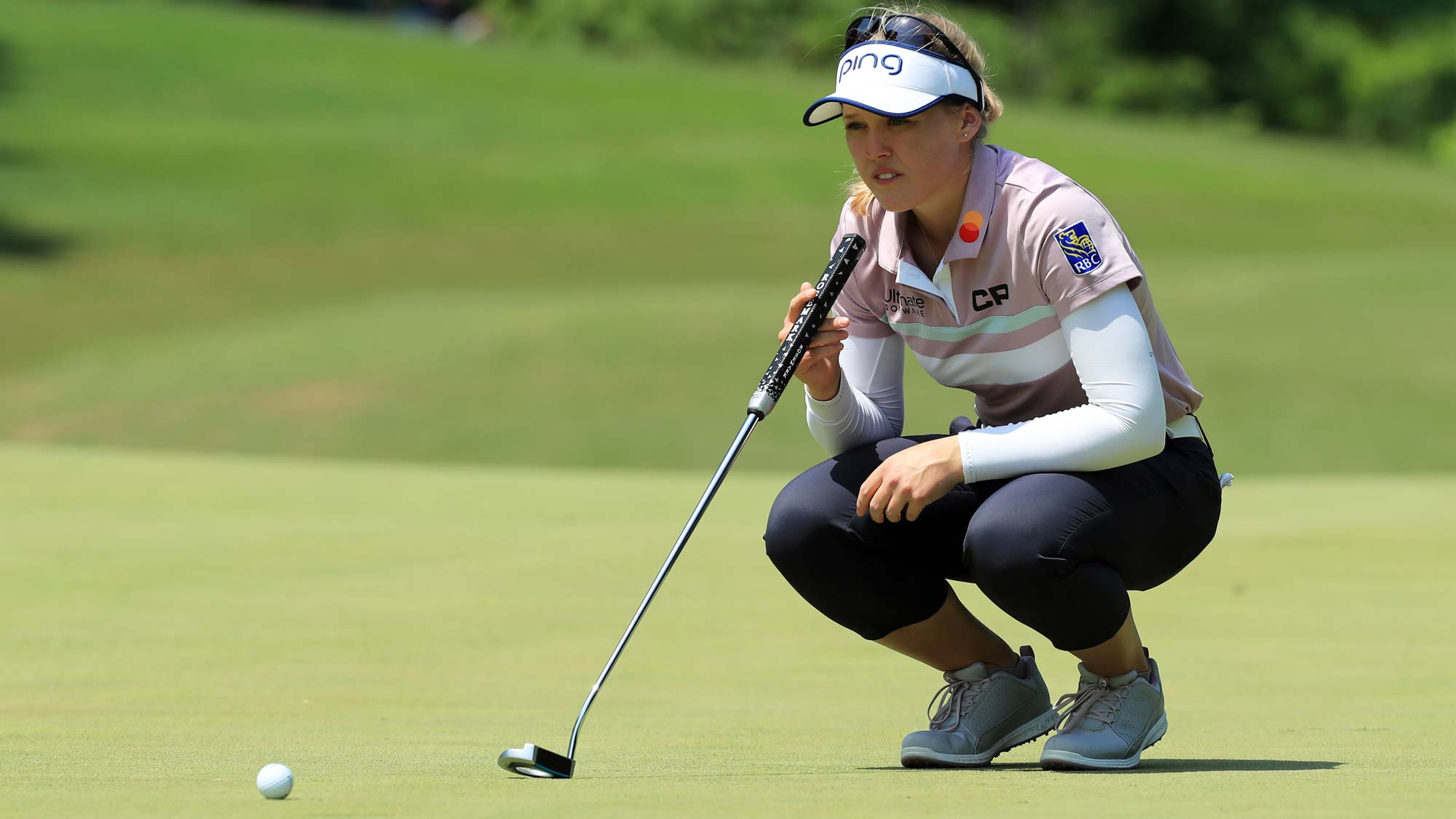 Brooke M. Henderson of Canada lines up her putt on the fourth hole during the first round of the Pure Silk Championship