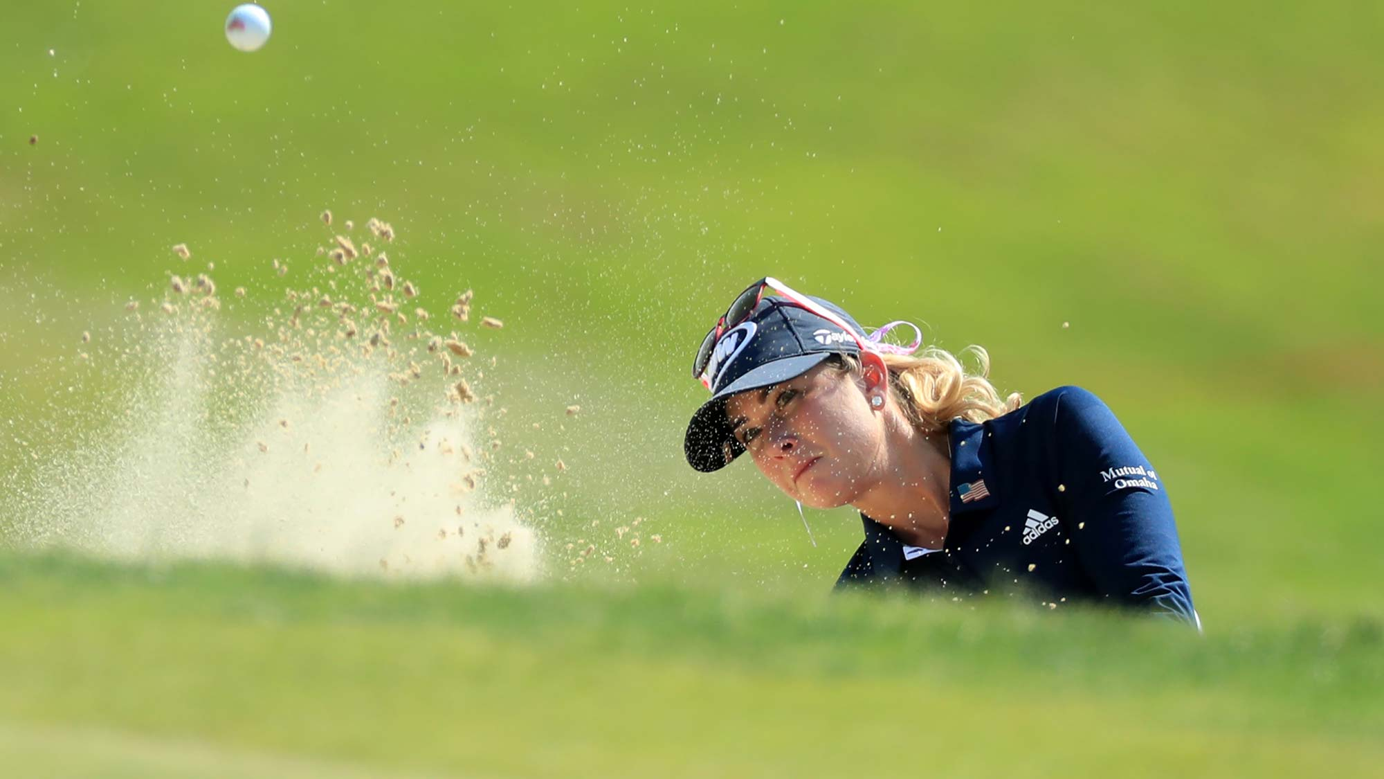 Paula Creamer hits out of a bunker on the 18th hole during the second round of the Pure Silk Championship