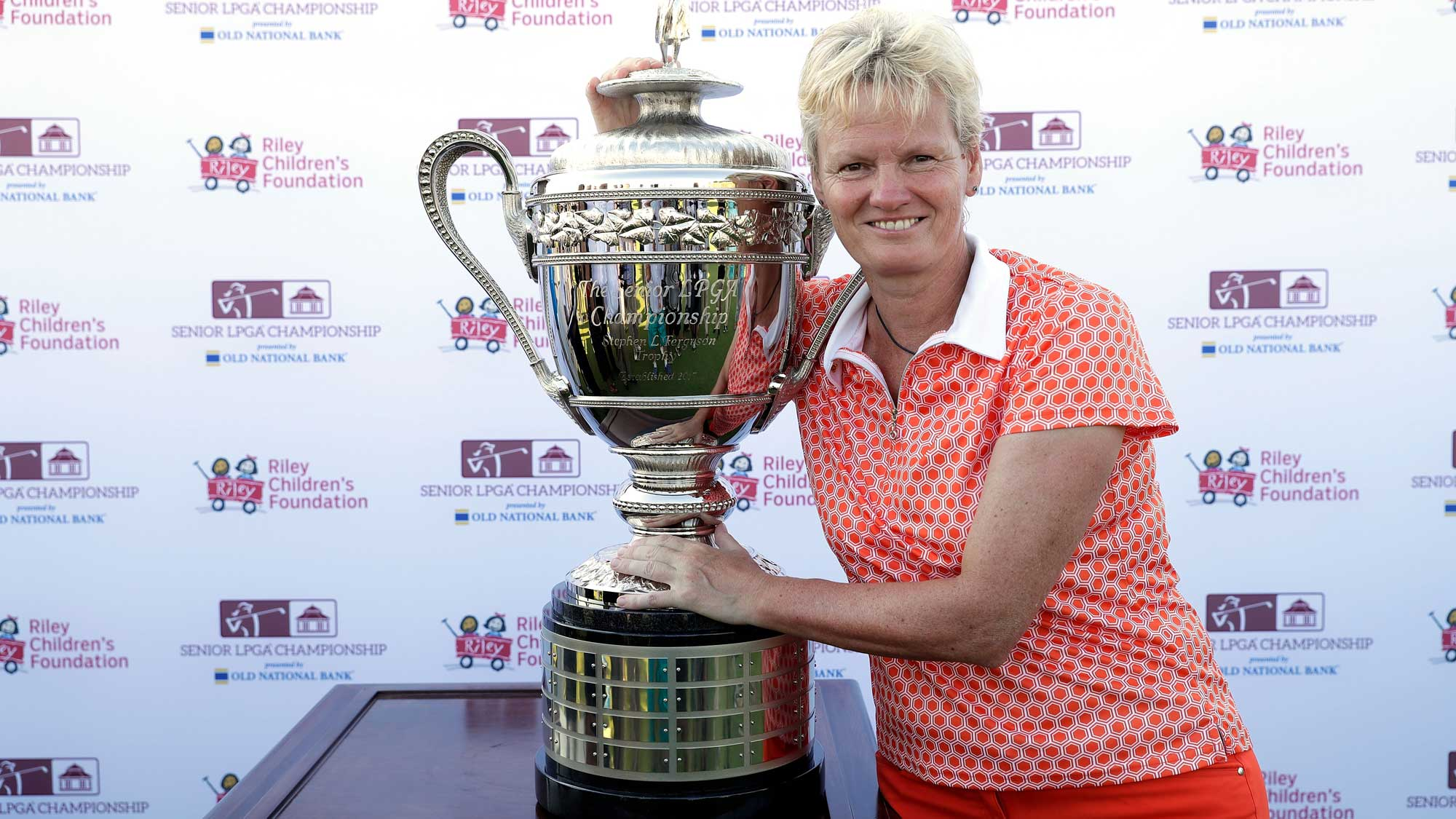 Trish Johnson of England poses with the trophy after winning the Senior LPGA Championship at the French Lick Resort