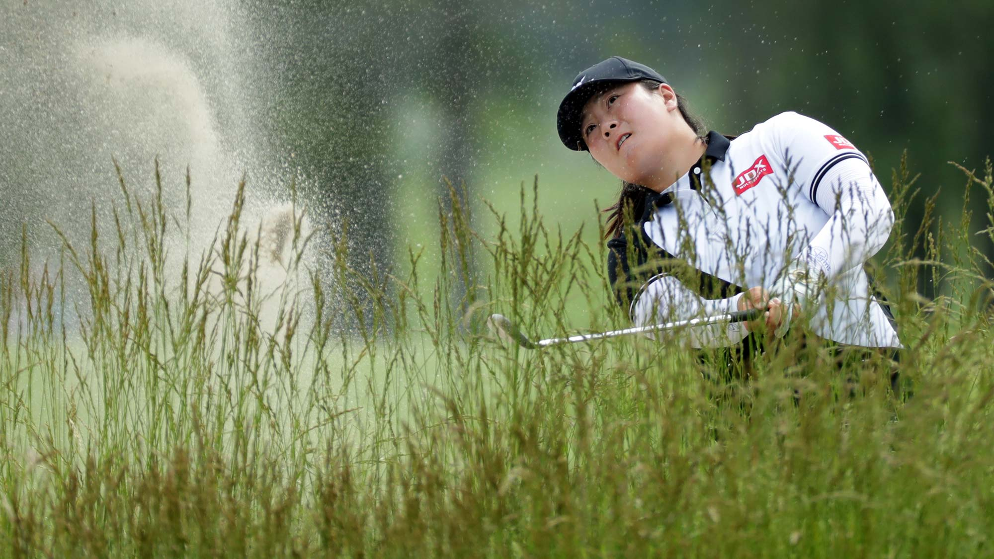 Angel Yin plays from a bunker on the fifth hole during the first round of the ShopRite LPGA Classic presented by Acer