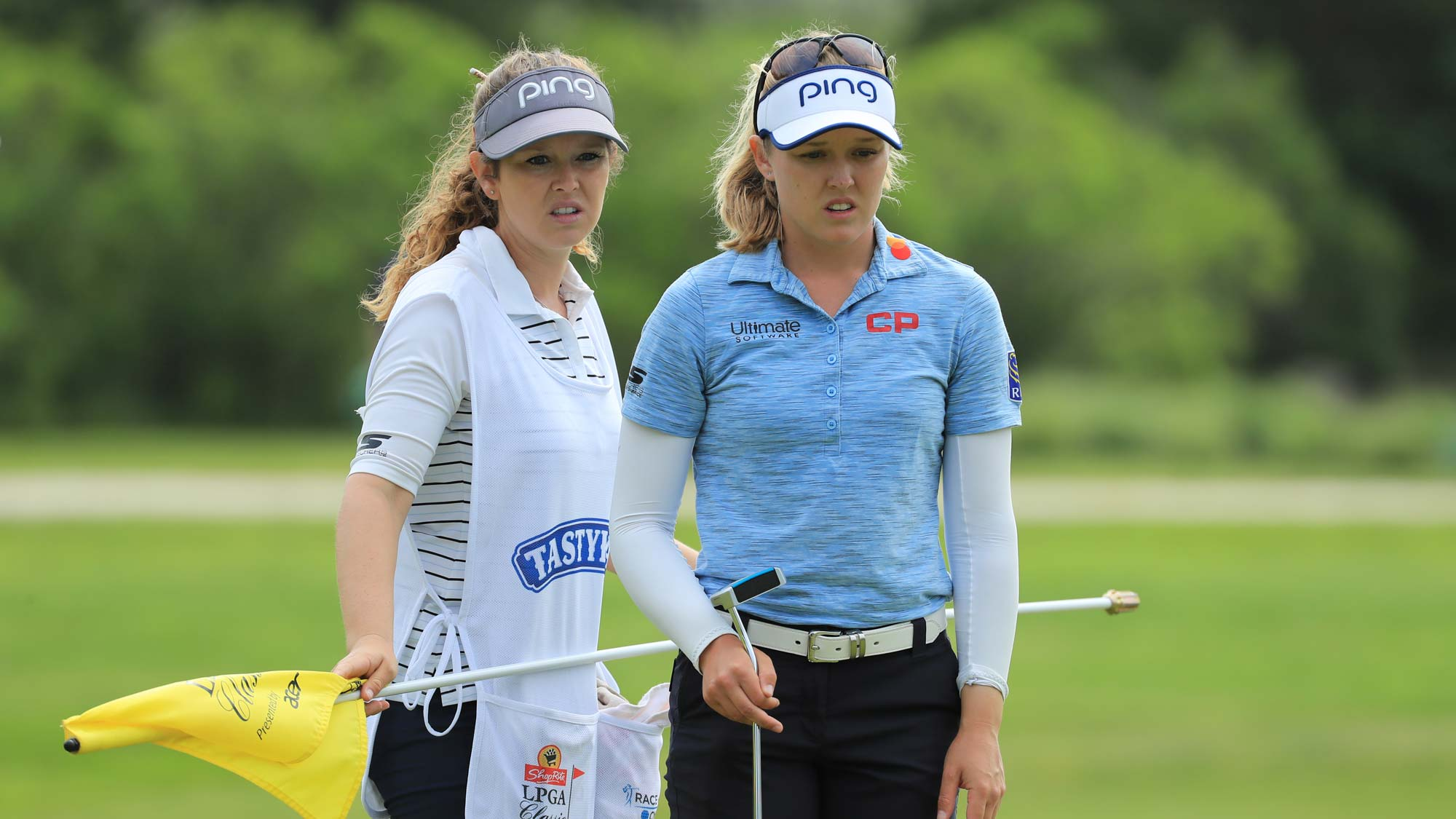 Brittany Henderson and Brooke M. Henderson line up a putt on the seventh hole during the first round of the ShopRite LPGA Classic presented by Acer
