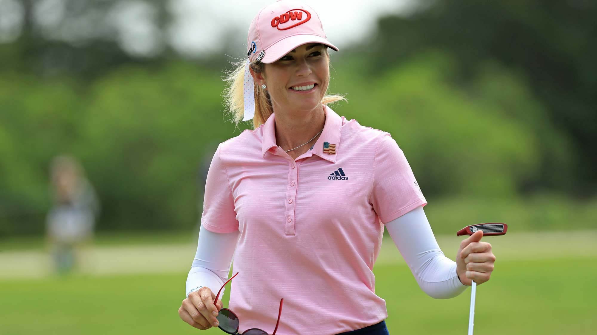 Paula Creamer smiles after putting out on the seventh hole during the first round of the ShopRite LPGA Classic presented by Acer