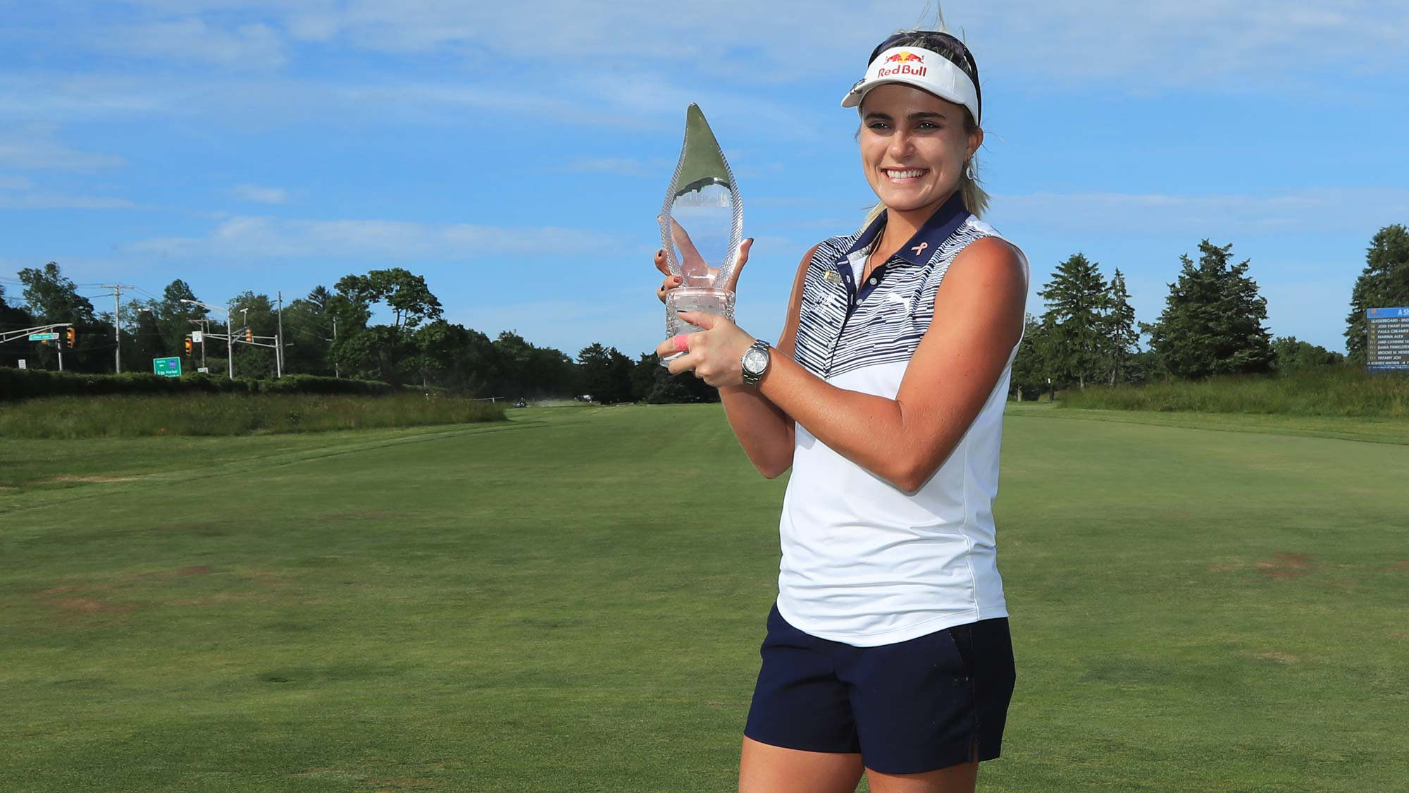 Lexi Thompson holds the championship trophy after winning the ShopRite LPGA Classic presented by Acer