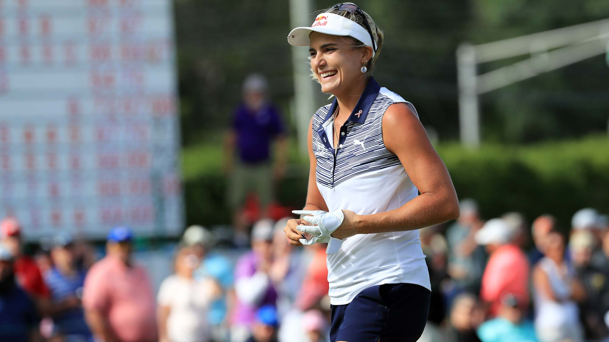 Lexi Thompson smiles as she walks off the green after making a putt for eagle on the 18th hole during the final round of the ShopRite LPGA Classic presented by Acer