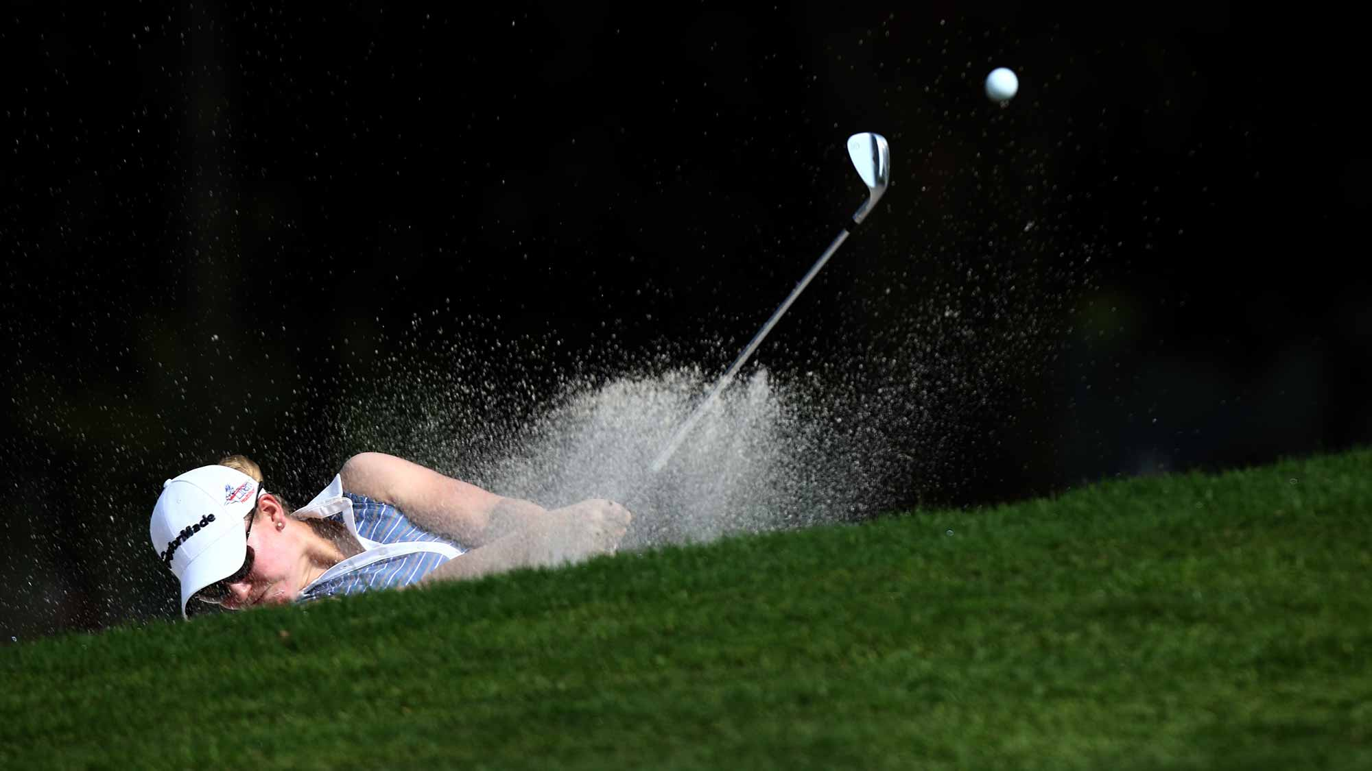 Austin Ernst of USA plays her bunker shot on the 6th hole during round one of the Sime Darby LPGA Tour at Kuala Lumpur Golf & Country Club