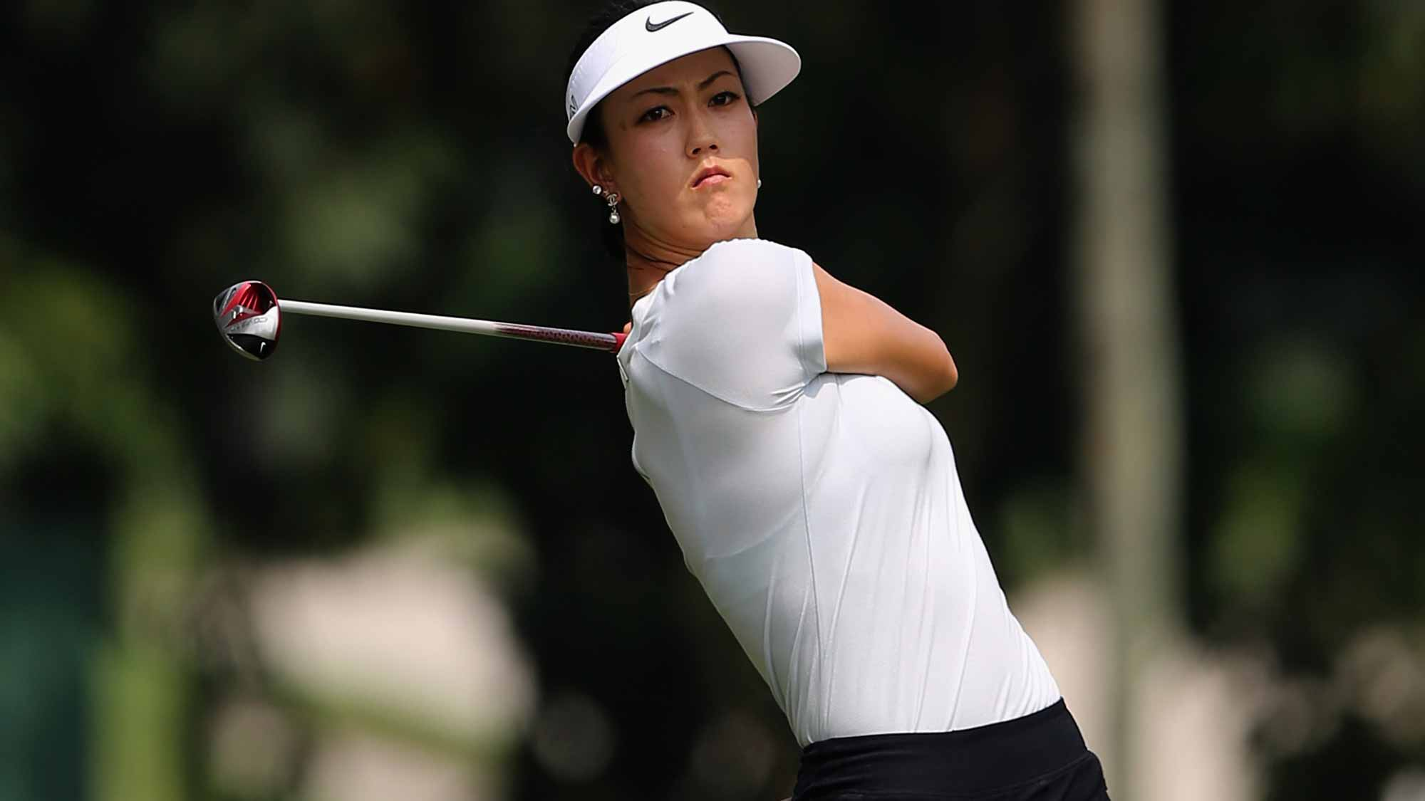 Michelle Wie of USA plays her 2nd shot on the 6th hole during round one of the Sime Darby LPGA Tour at Kuala Lumpur Golf & Country Club