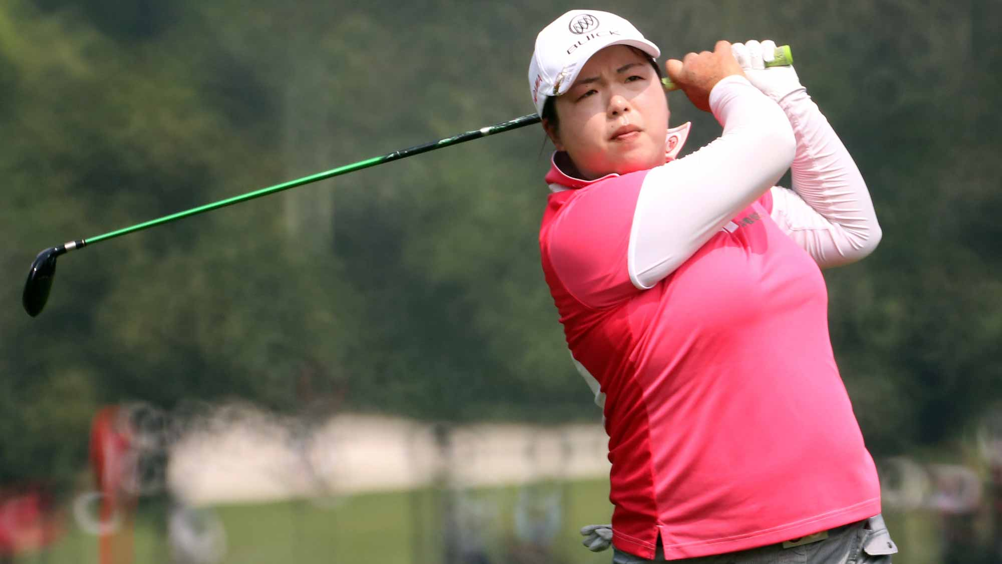Shanshan Feng of China watches her 2nd shot on the 6th hole during round one of the Sime Darby LPGA Tour at Kuala Lumpur Golf & Country Club