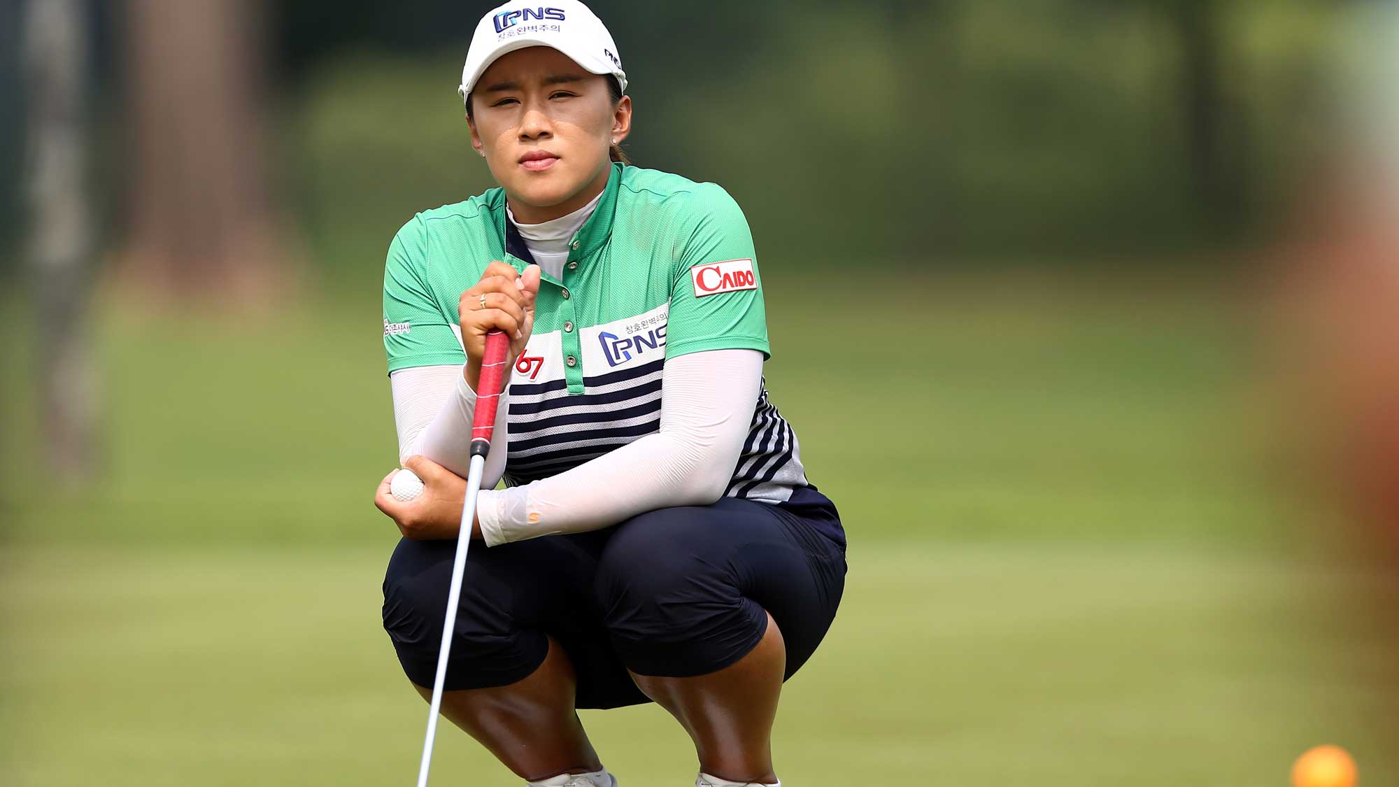 Amy Yang of South Korea waits for her turn to putt on the 3rd hole during round three of the Sime Darby LPGA Tour at Kuala Lumpur Golf & Country Club