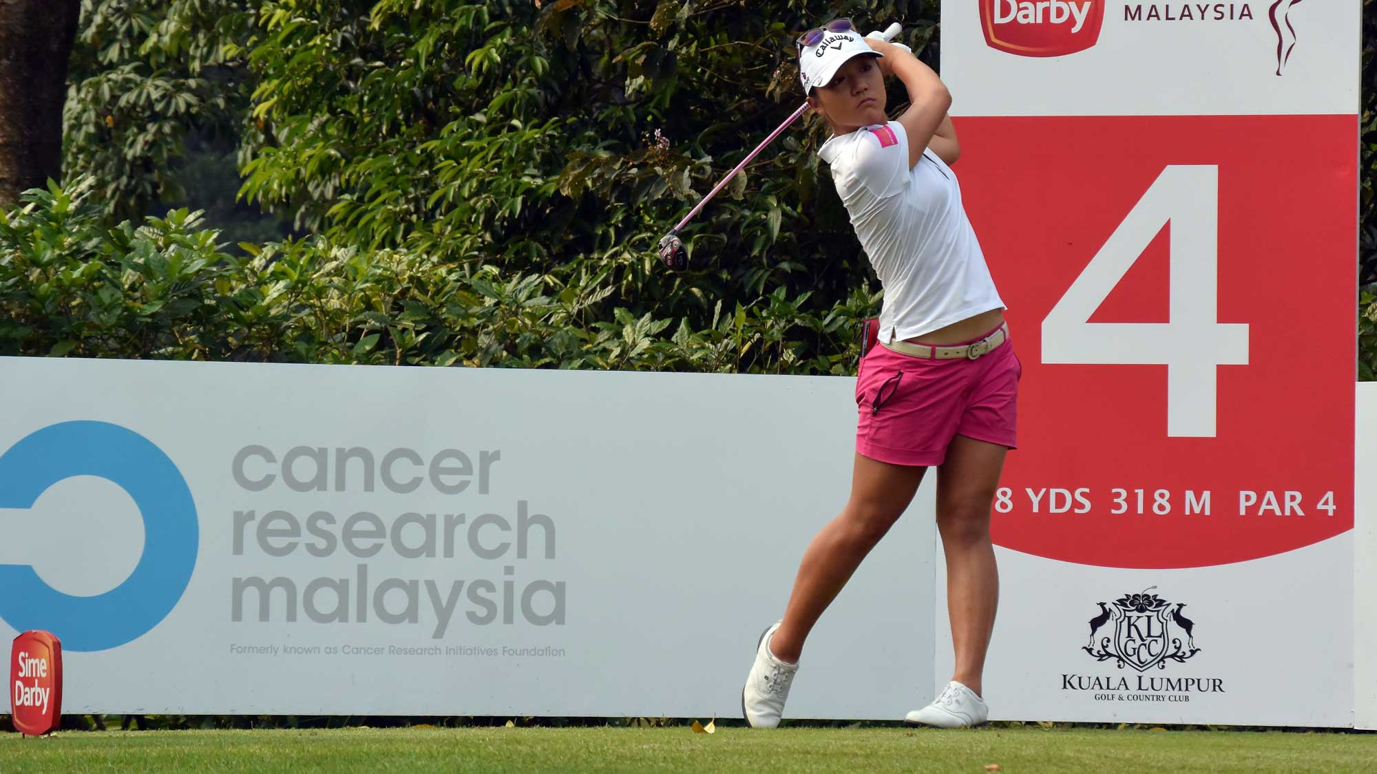 Lydia Ko of New Zealand watches her tee shot on the 4th hole during round three of the Sime Darby LPGA Tour at Kuala Lumpur Golf & Country Club