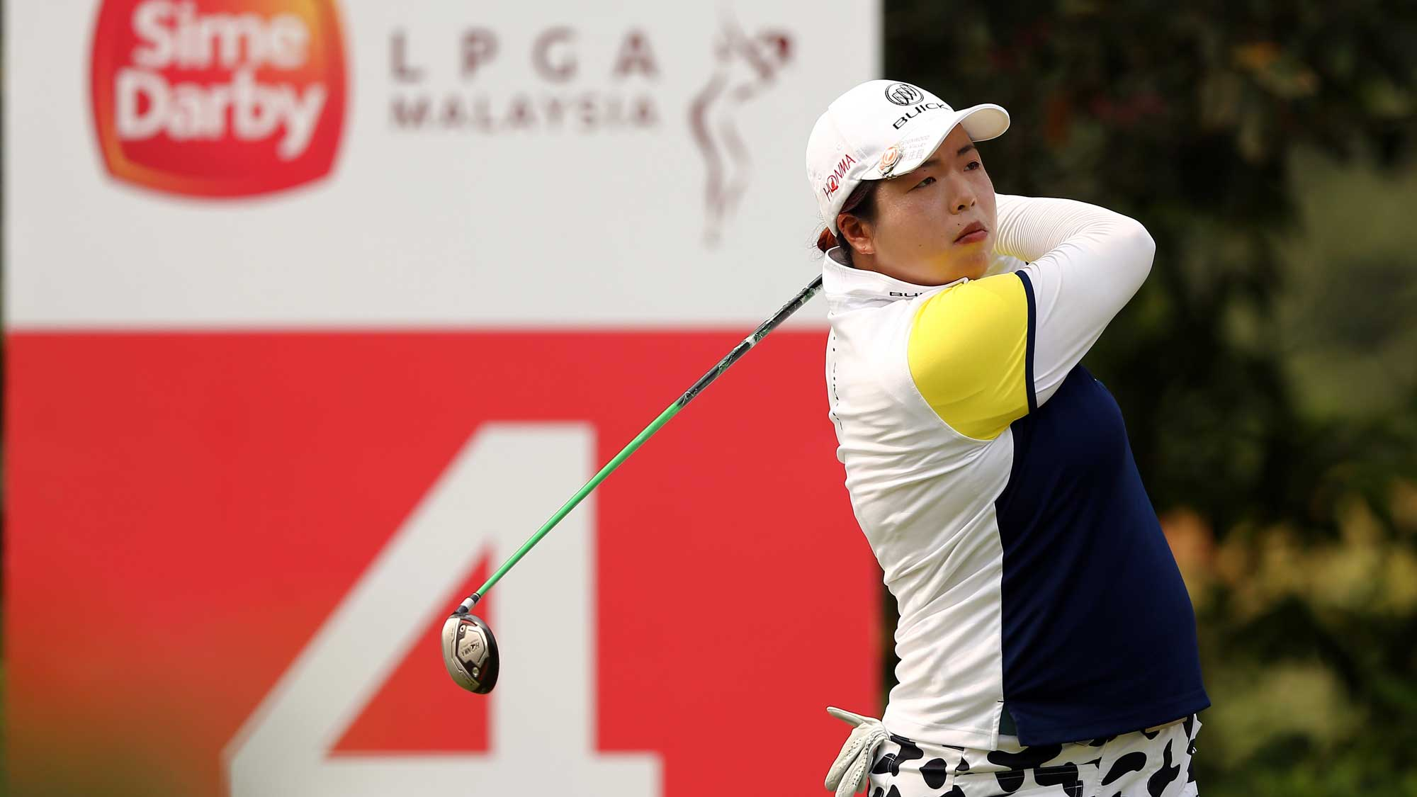 Shanshan Feng of China watches her tee shot on the 4th hole during round three of the Sime Darby LPGA Tour at Kuala Lumpur Golf & Country Club