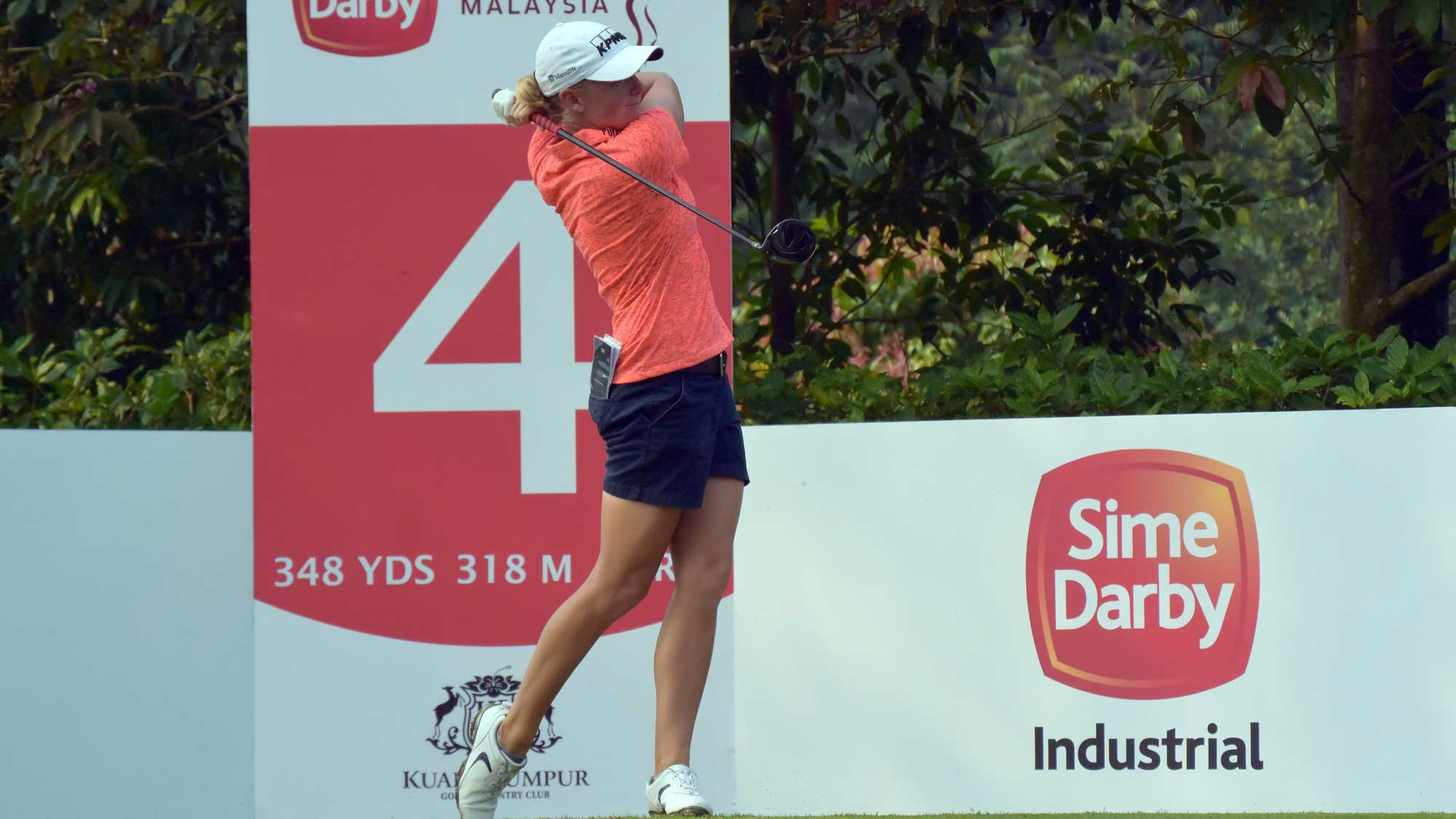 Stacy Lewis of USA watches her tee shot on the 4th hole during round three of the Sime Darby LPGA Tour at Kuala Lumpur Golf & Country Club