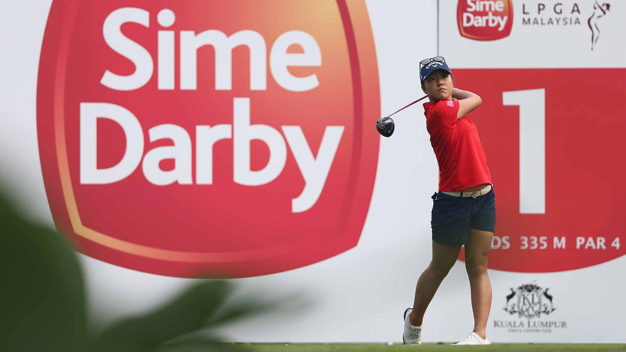 Lydia Ko of New Zealand watches her tee shot on the 1st hole during the final round of the Sime Darby LPGA Tour at Kuala Lumpur Golf & Country Club