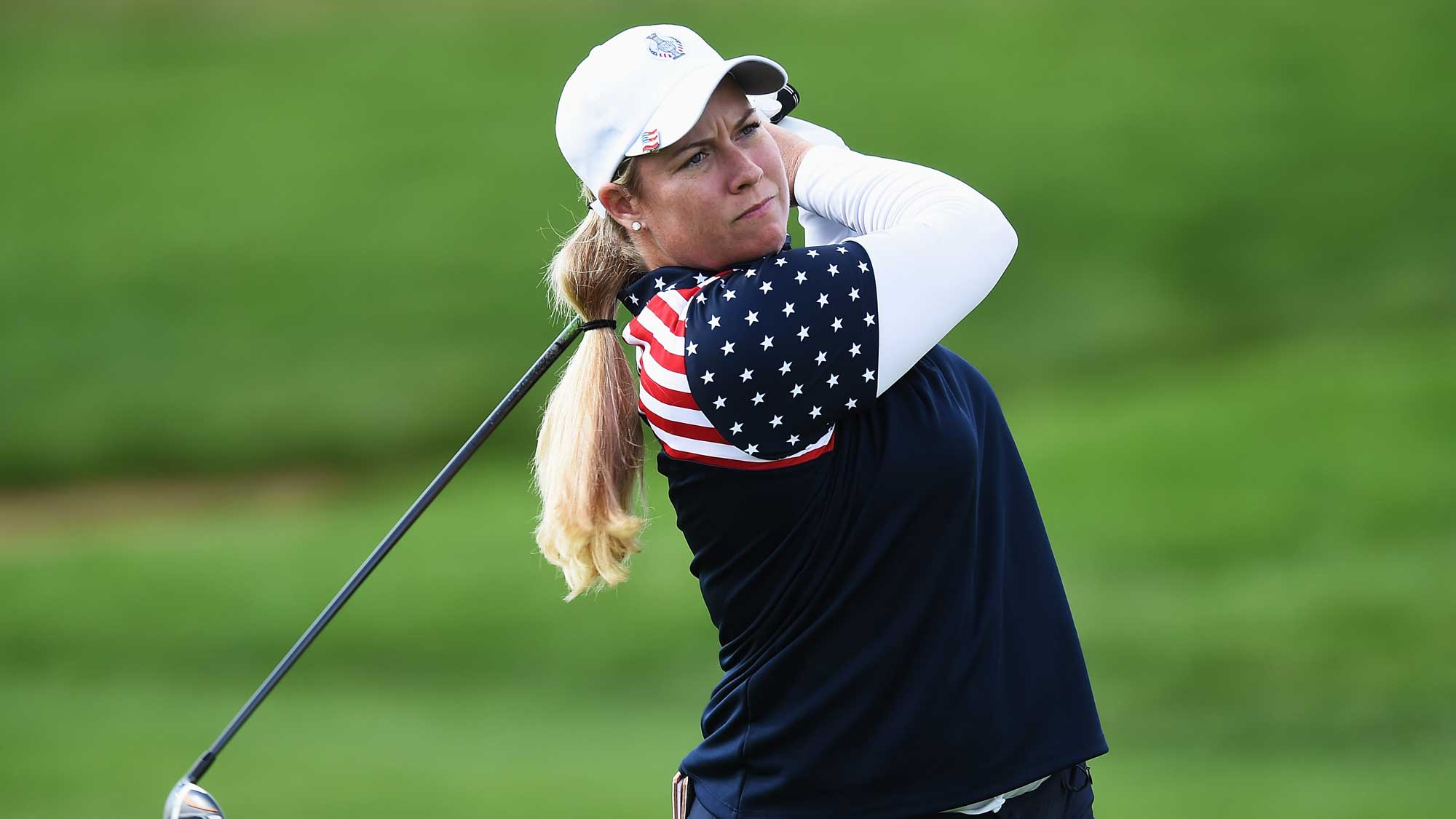 Brittany Linicome of team USA plays a shot during the singles matches of the 2015 Solheim Cup