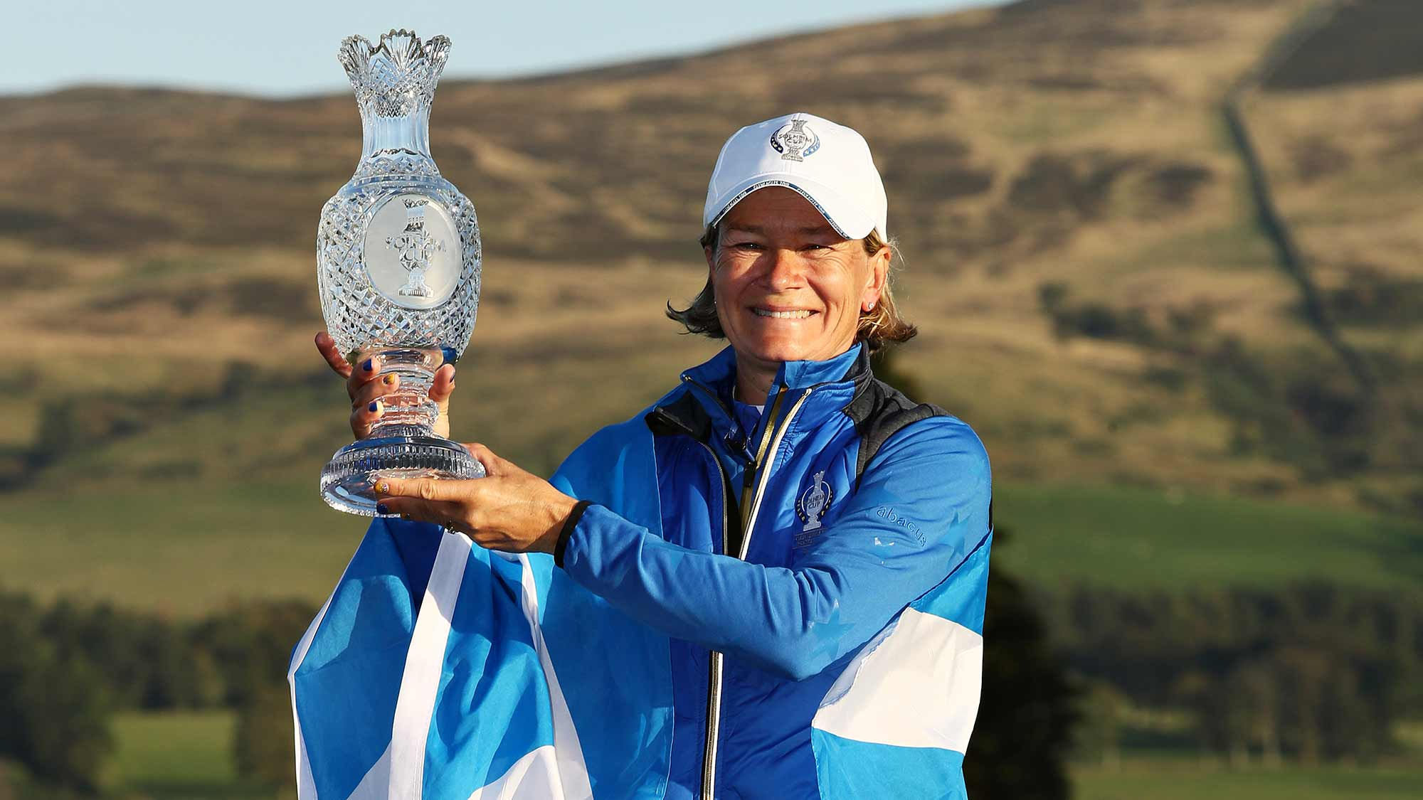 Team Europe captain Catriona Matthew celebrates her teams win with the Solheim Cup during the final day singles matches of the Solheim Cup at Gleneagles on September 15, 2019 in Auchterarder, Scotland