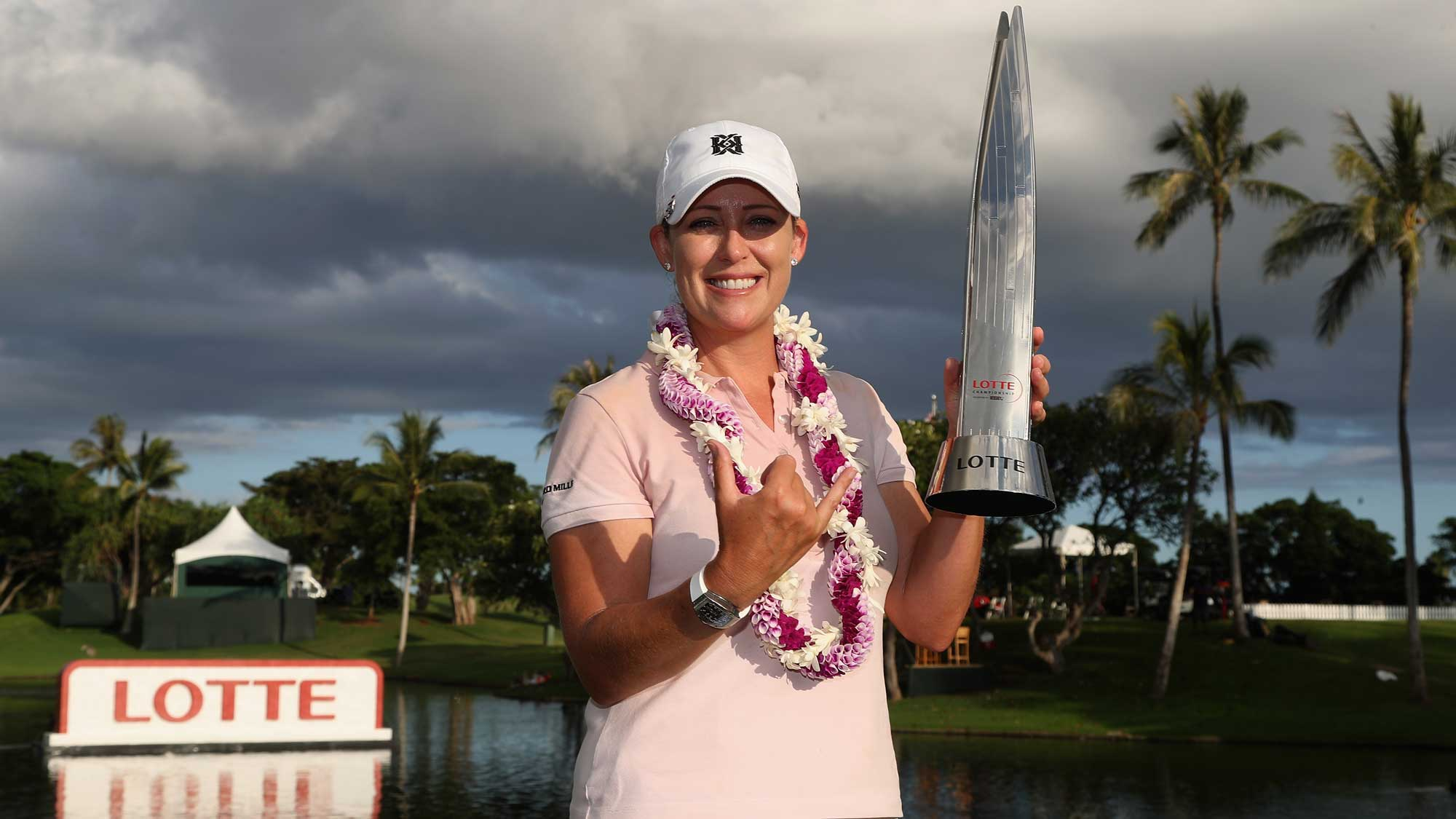 Cristie Kerr holds the LOTTE Championship Trophy presented by HERSHEY