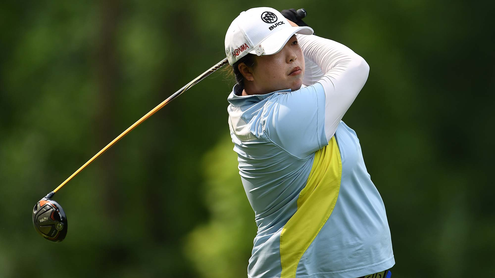Shanshan Feng of China hits her tee shot on the third hole during the final round of the Thornberry Creek LPGA Classic