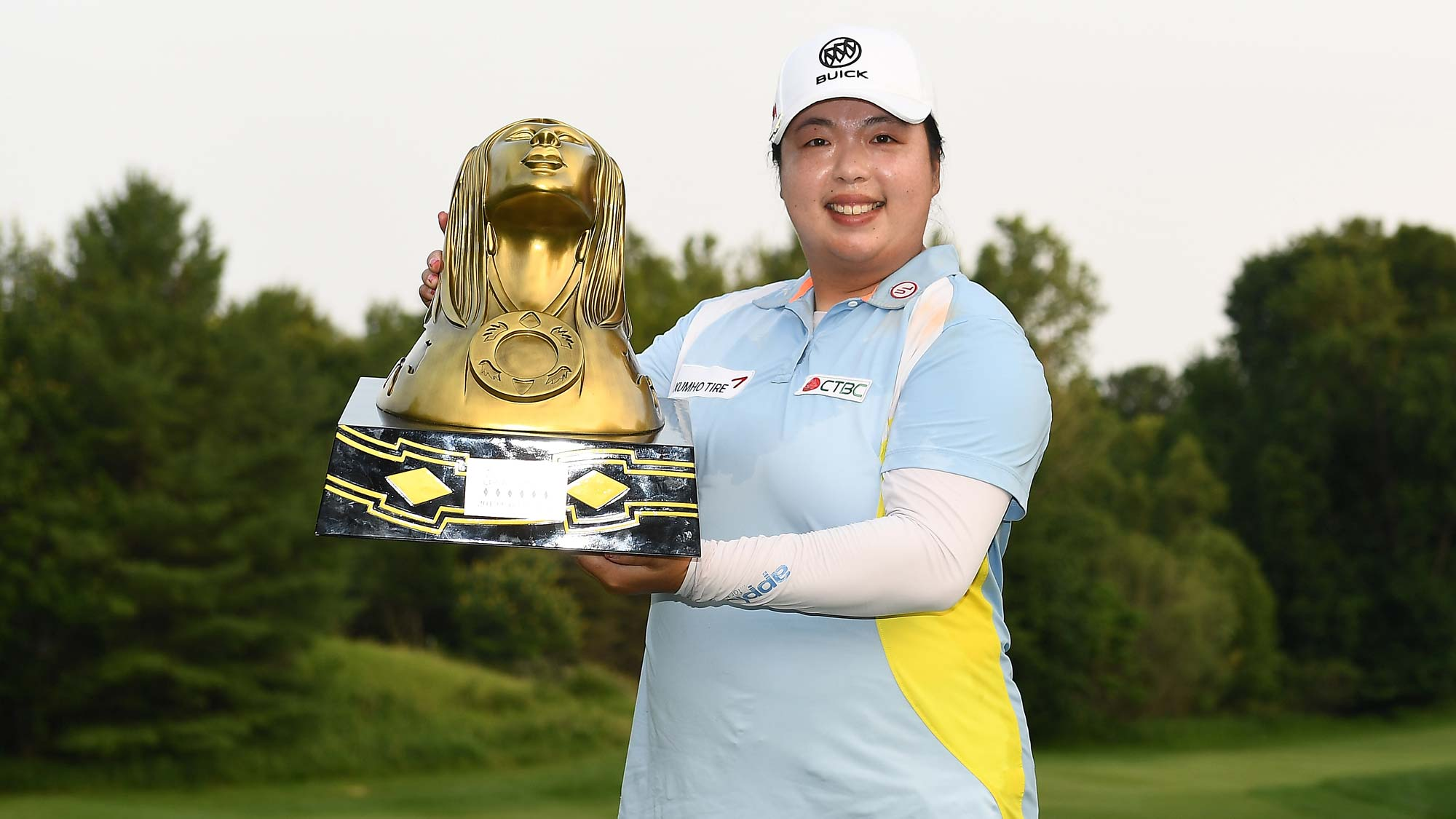 Shanshan Feng of China poses with the trophy after winning the Thornberry Creek LPGA Classic