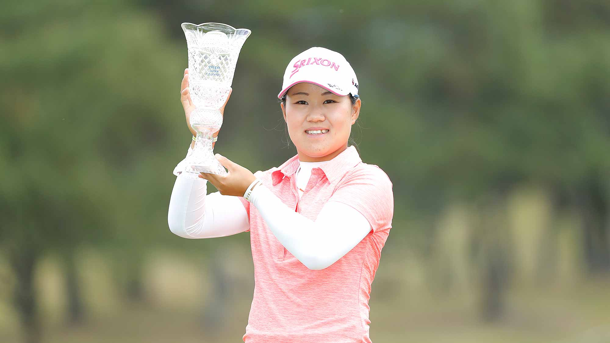 Nasa Hataoka of Japan holds the winner's trophy after winning the TOTO Japan Classic at Seta Golf Course on November 04, 2018 in Otsu, Shiga, Japan