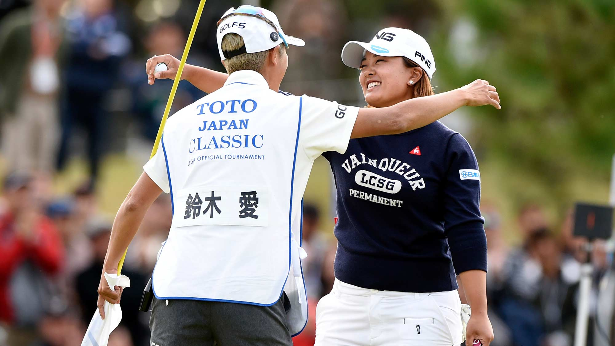 Ai Suzuki hugs caddy after winning TOTO Japan Classic