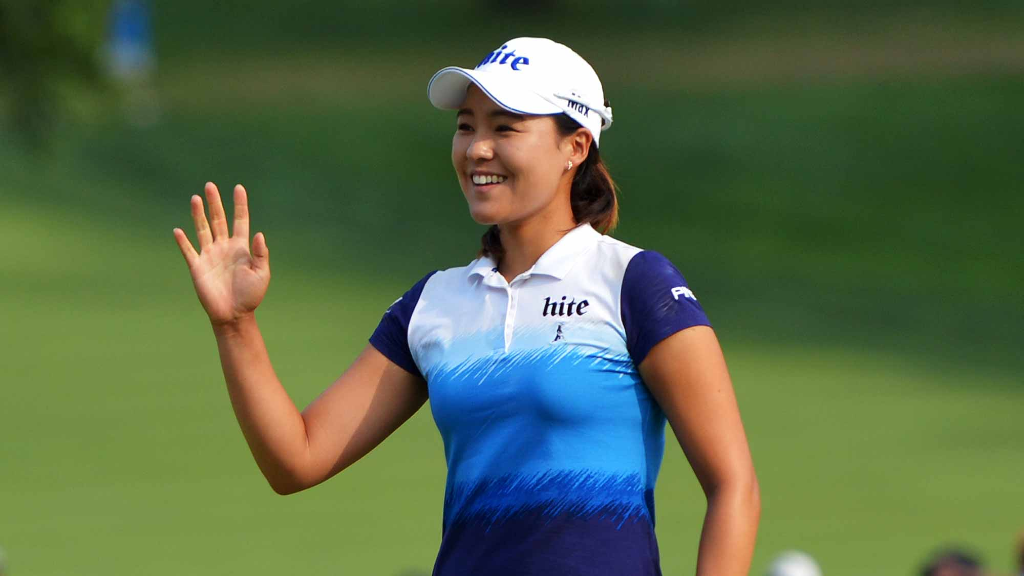 In Gee Chun of South Korea waves to the gallery after making birdie on the 16th hole during the final round of the U.S. Women's Open at Lancaster Country Club