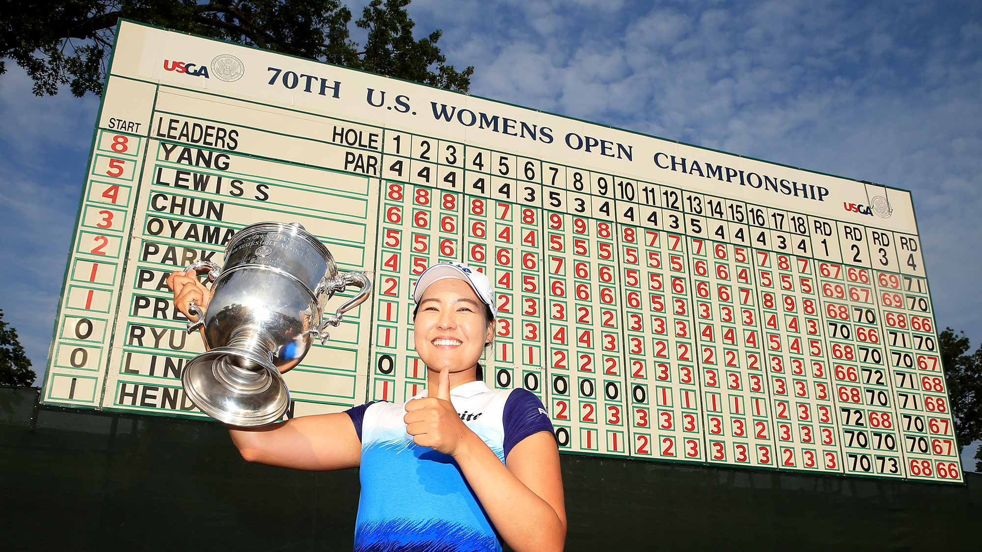 In Gee Chun of South Korea poses with the trophy after winning the U.S. Women's Open at Lancaster Country Club