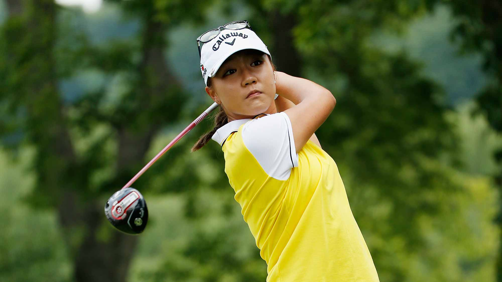 Lydia Ko of New Zealand watches her tee shot on the second hole during the final round of the U.S. Women's Open at Lancaster Country Club