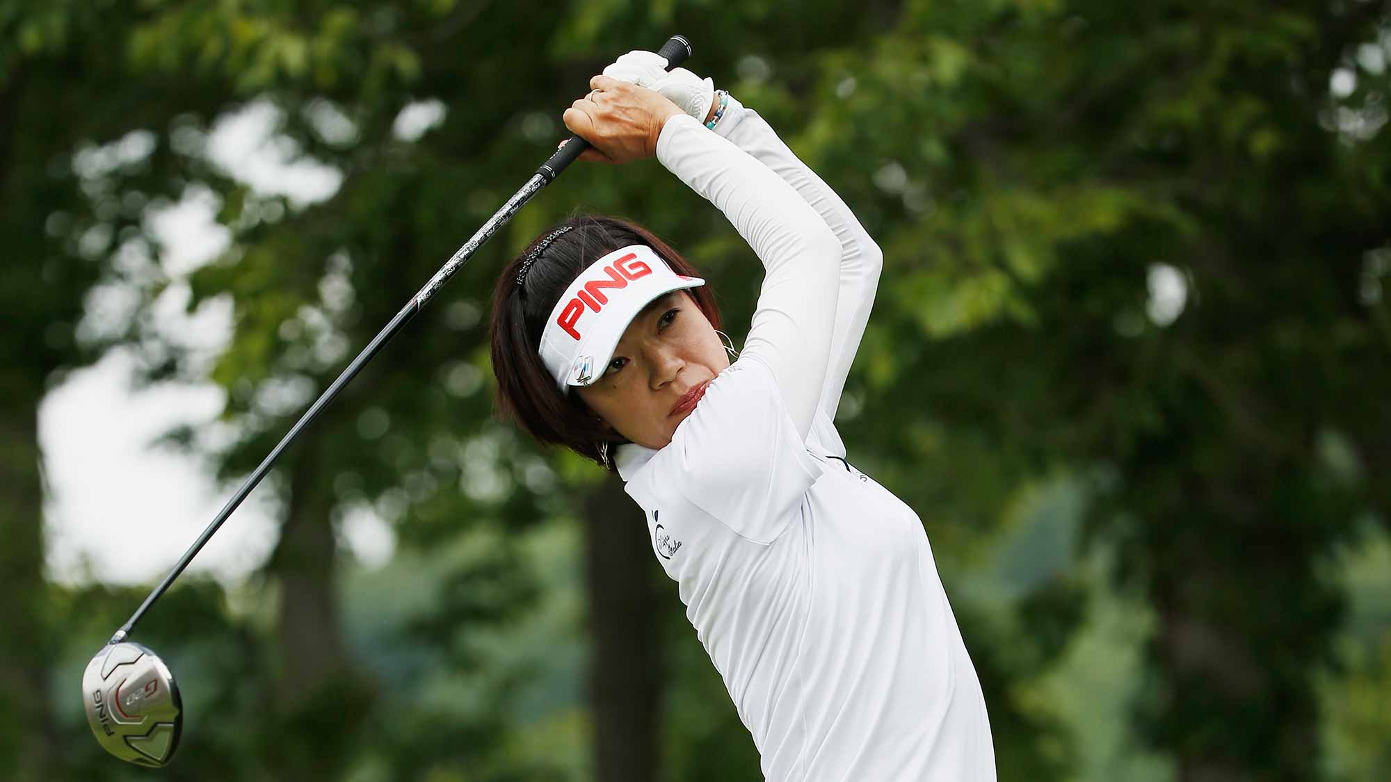 Shiho Oyama of Japan watches her tee shot on the second hole during the final round of the U.S. Women's Open at Lancaster Country Club