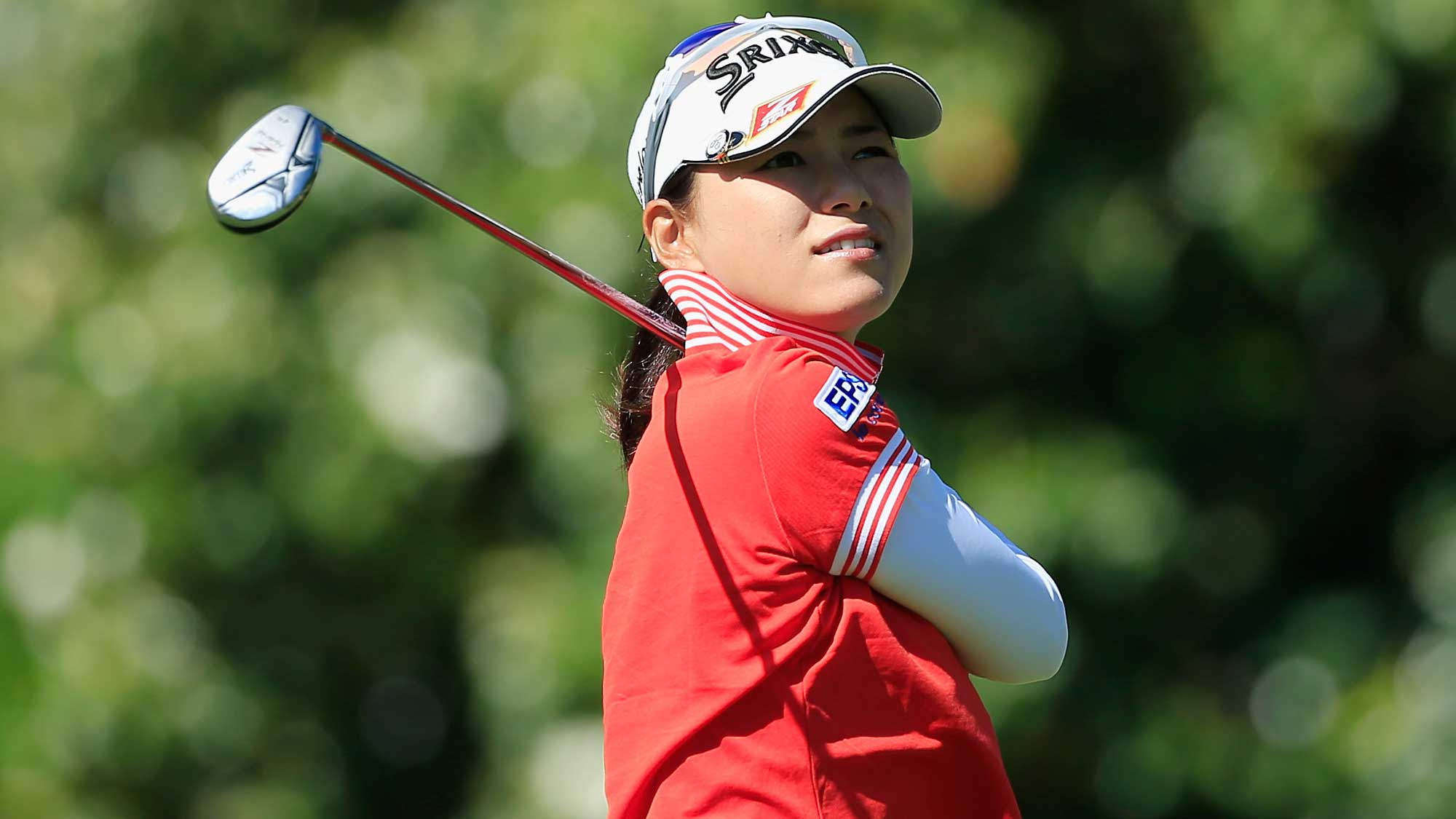 Sakura Yokomine of Japan watches her tee shot on the sixth hole during the first round of the Volunteers of America Texas Shootout
